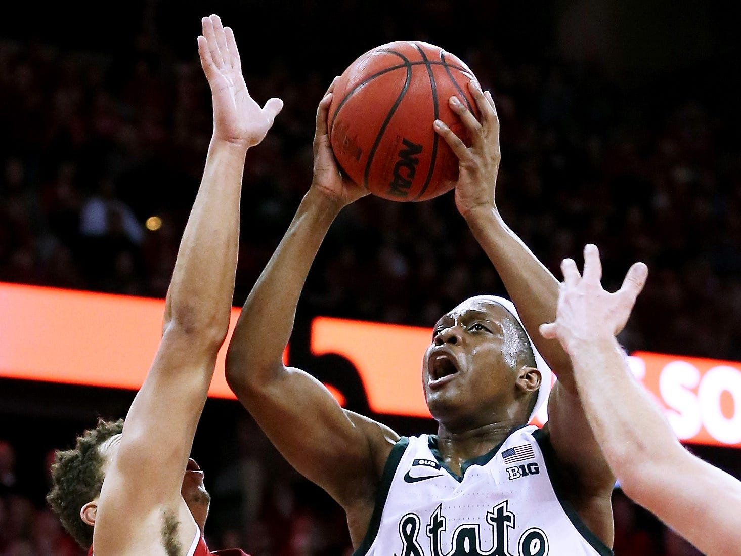 Michigan State's Cassius Winston (5)  attempts a shot while being guarded by Wisconsin's Kobe King (23) of the Wisconsin Badgers in the second half.