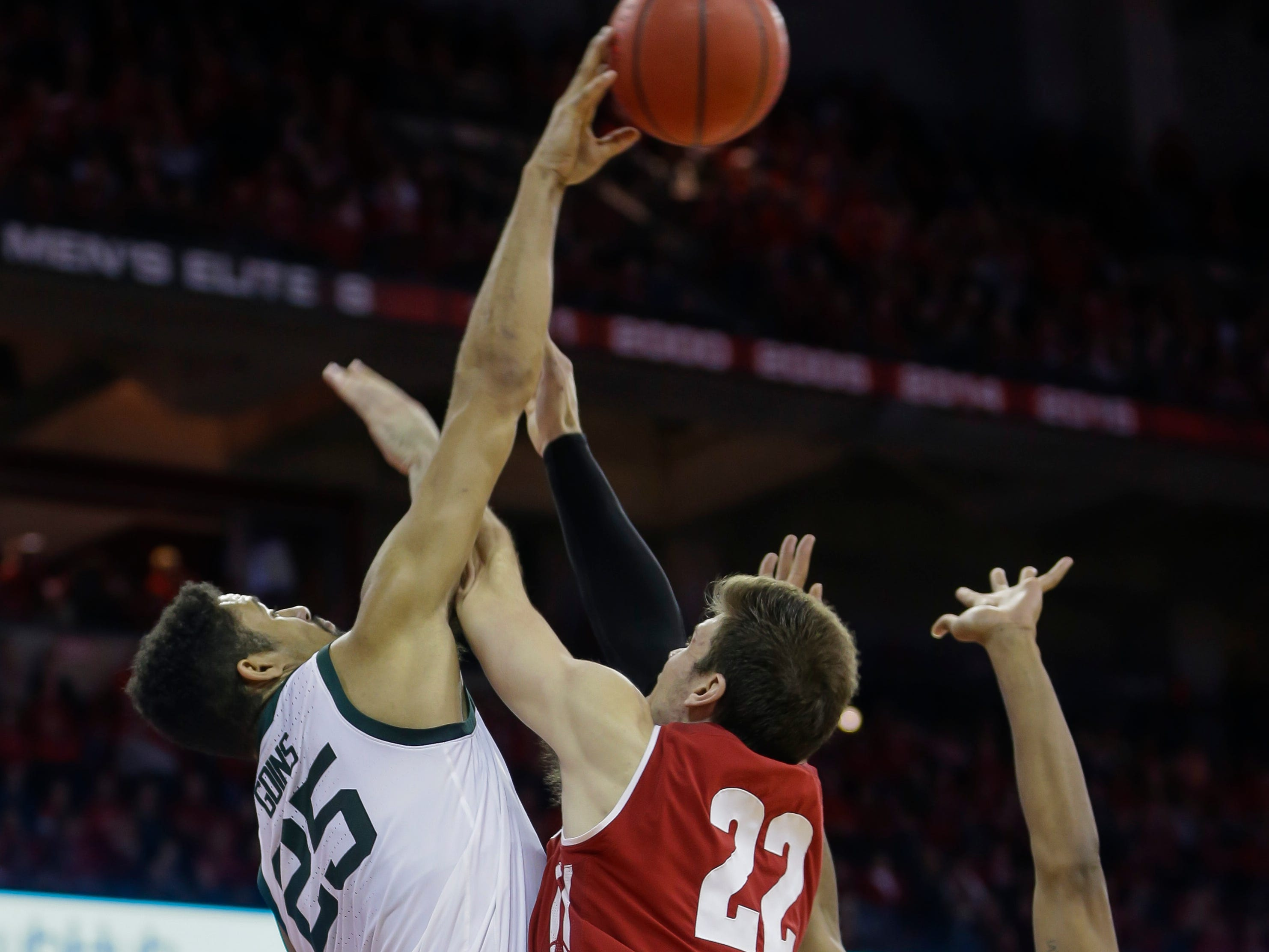 Michigan State's Kenny Goins (25) blocks a shot by Wisconsin's Ethan Happ (22) during the second half.