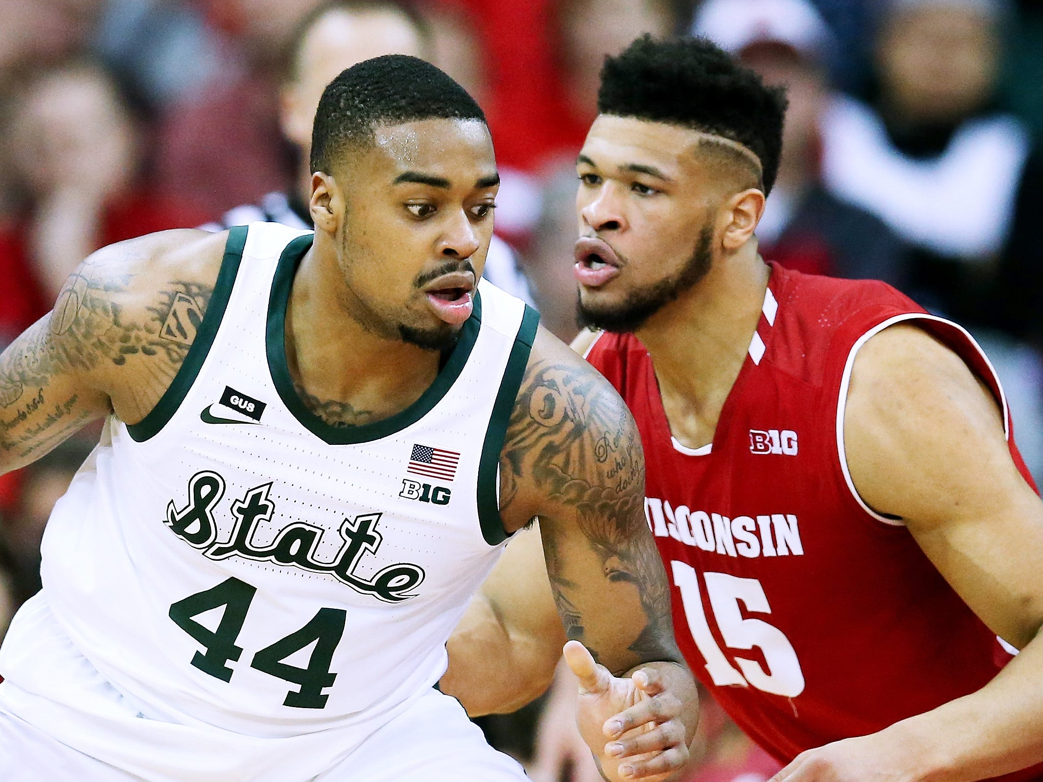 Michigan State's Nick Ward (44) dribbles the ball while being guarded by Wisconsin's Charles Thomas IV (15) in the first half at the Kohl Center on February 12, 2019 in Madison, Wisconsin.
