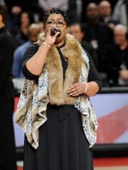 LaShell Renee performs the national anthem before Monday's game between the Pistons and Washington Wizards.