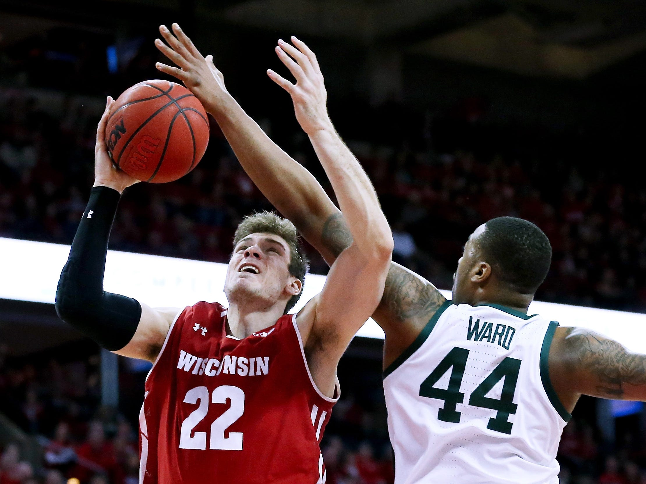 Michigan State's Nick Ward (44) blocks a shot attempt by Wisconsin's Ethan Happ (22) in the first half.