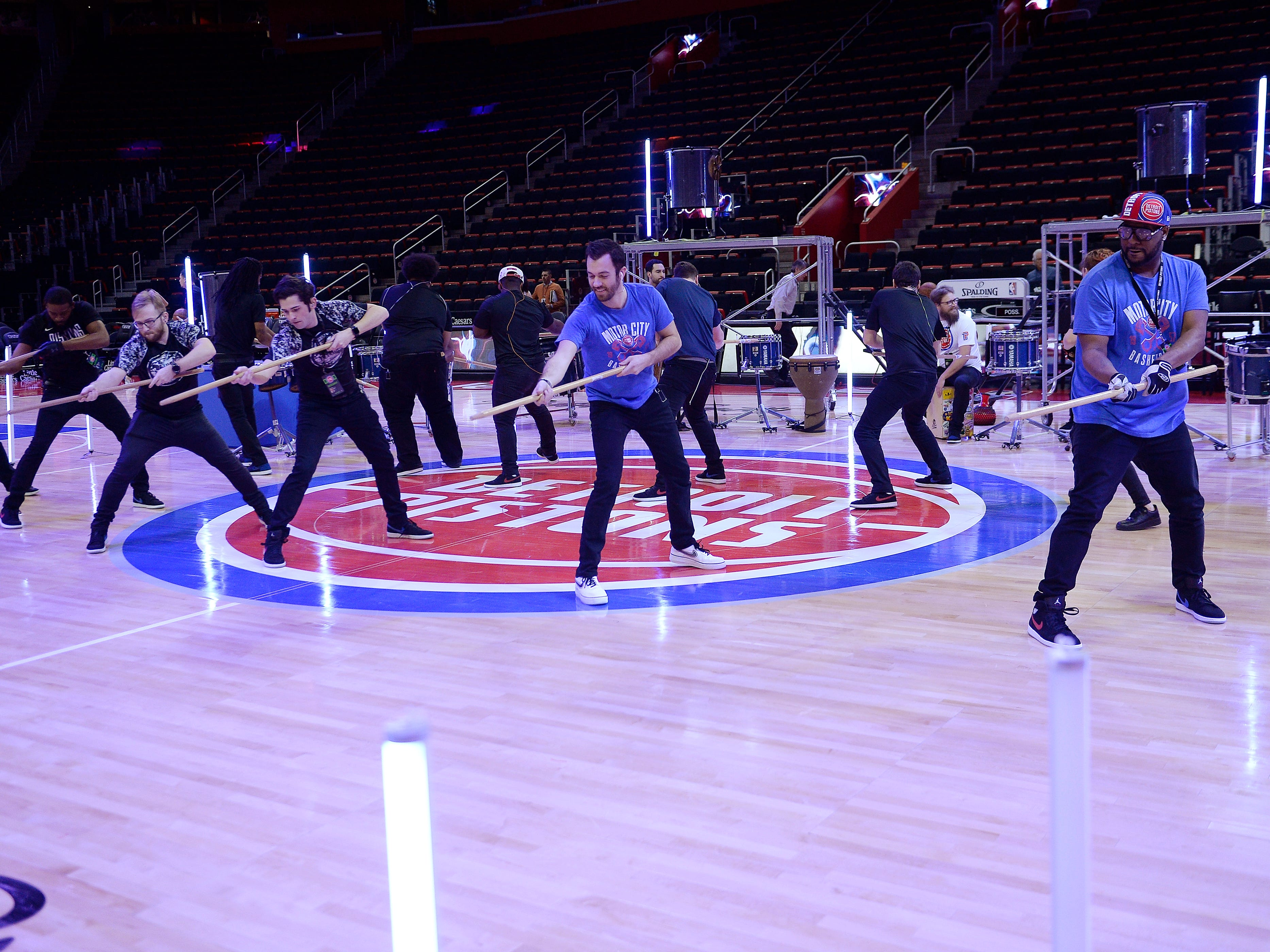 The Pistons Drumline team practice their routine before the game.