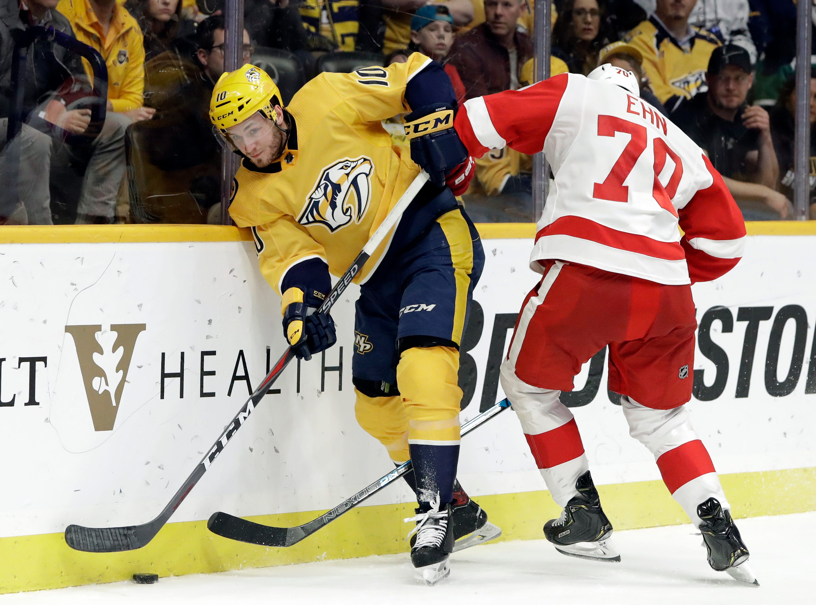 Nashville Predators center Colton Sissons (10) and Detroit Red Wings center Christoffer Ehn (70), of Sweden, battle for the puck during the second period.