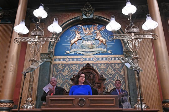 Flanked by  Senate Majority leader Mike Shirkey, left, and Speaker of the House Lee Chatfield Gov. Gretchen Whitmer delivers her State of the State speech.