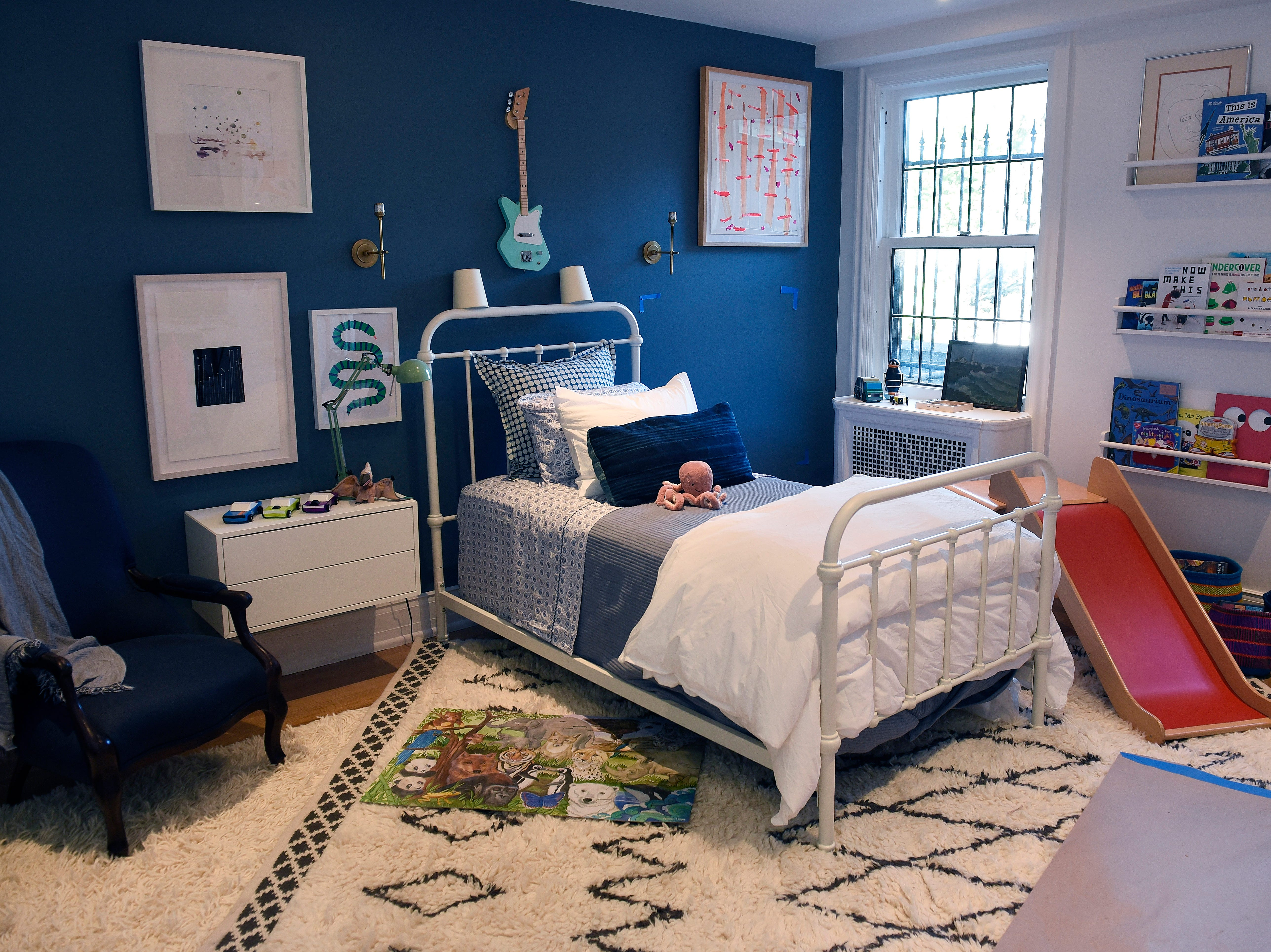 "For a children's bedroom she designed for last year's Junior League of Detroit's Designers' Show House, designer Erica Harrison used Benjamin Moore's Phillisburg Blue and Atrium White. ""My favorite way to insert blue into homes is in matte blue: walls, trim, windows,  ceiling—all the same finish,"" says Harrison. ""I love white as a classic combination with blue as well — very East Coast seaboard or with a high gloss black."""