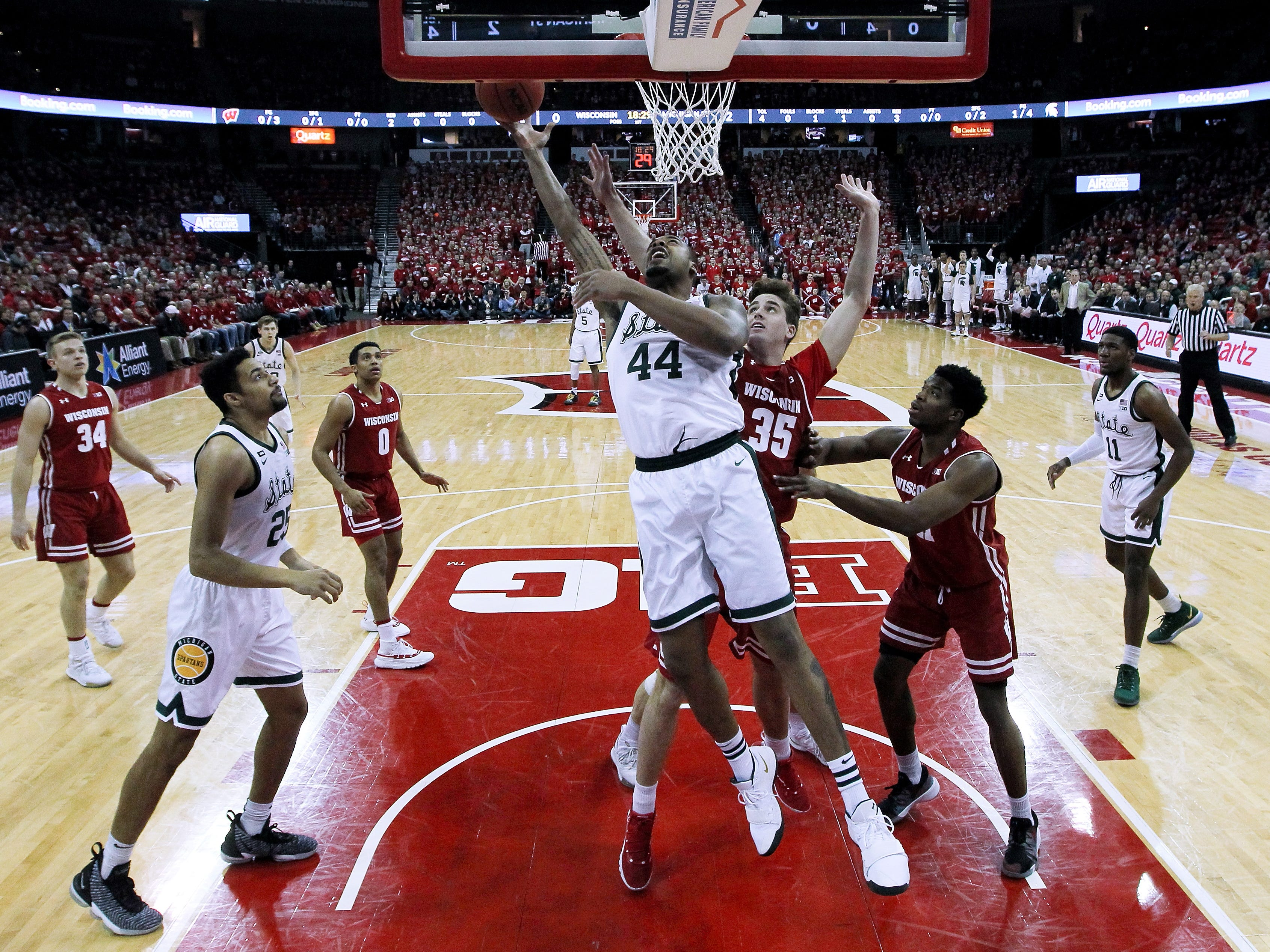 Michigan State's Nick Ward (44) attempts a shot while being guarded by Wisconsin's Nate Reuvers (35) in the first half.