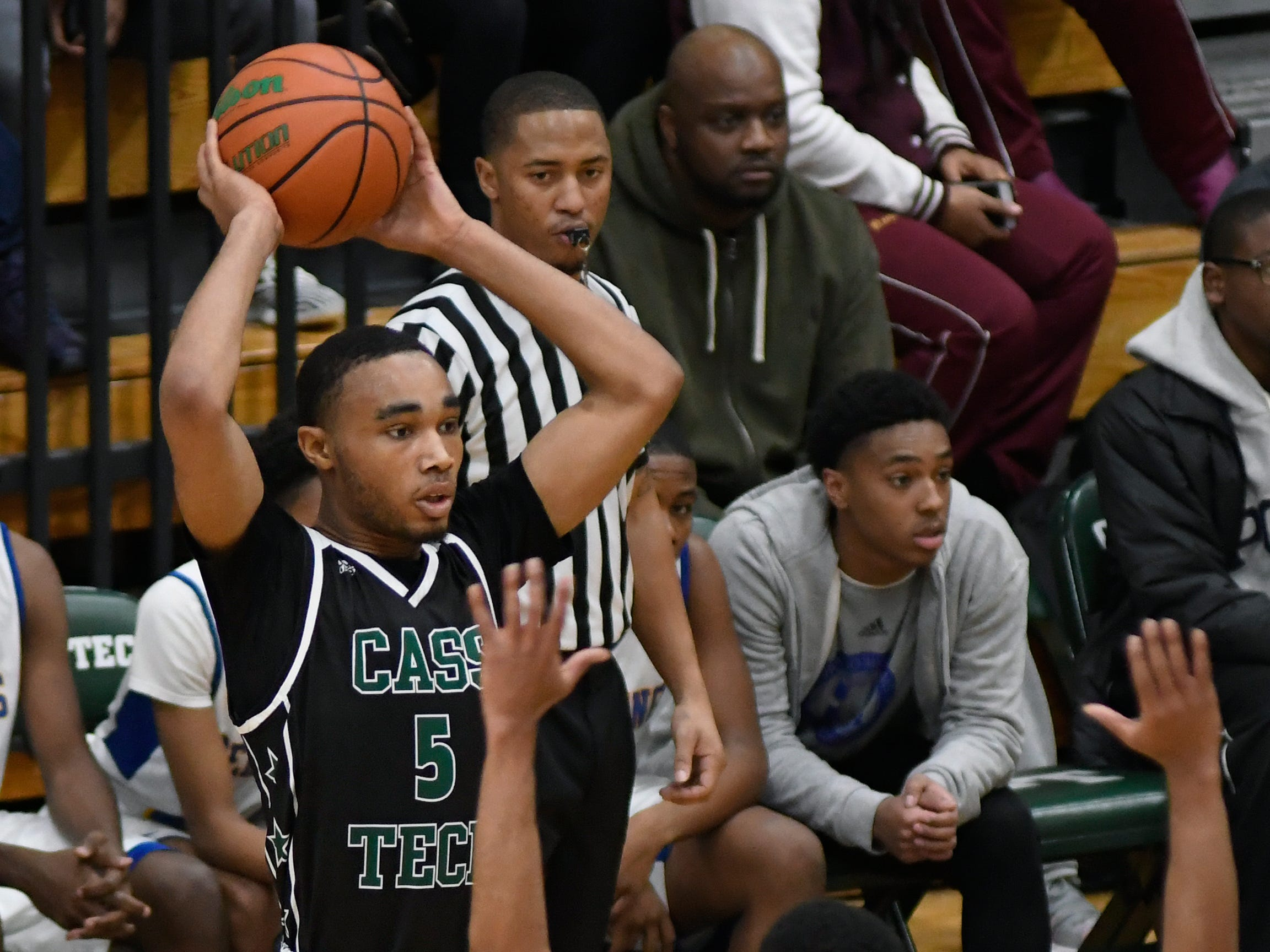 Cass Tech's Daniel Autry (5) looks to pass against Pershing during the second quarter, Tuesday, Feb. 12, 2019, in a PSL boys basketball semifinal held at Cass Tech HS in Detroit.  (Jose Juarez/Special to Detroit News)