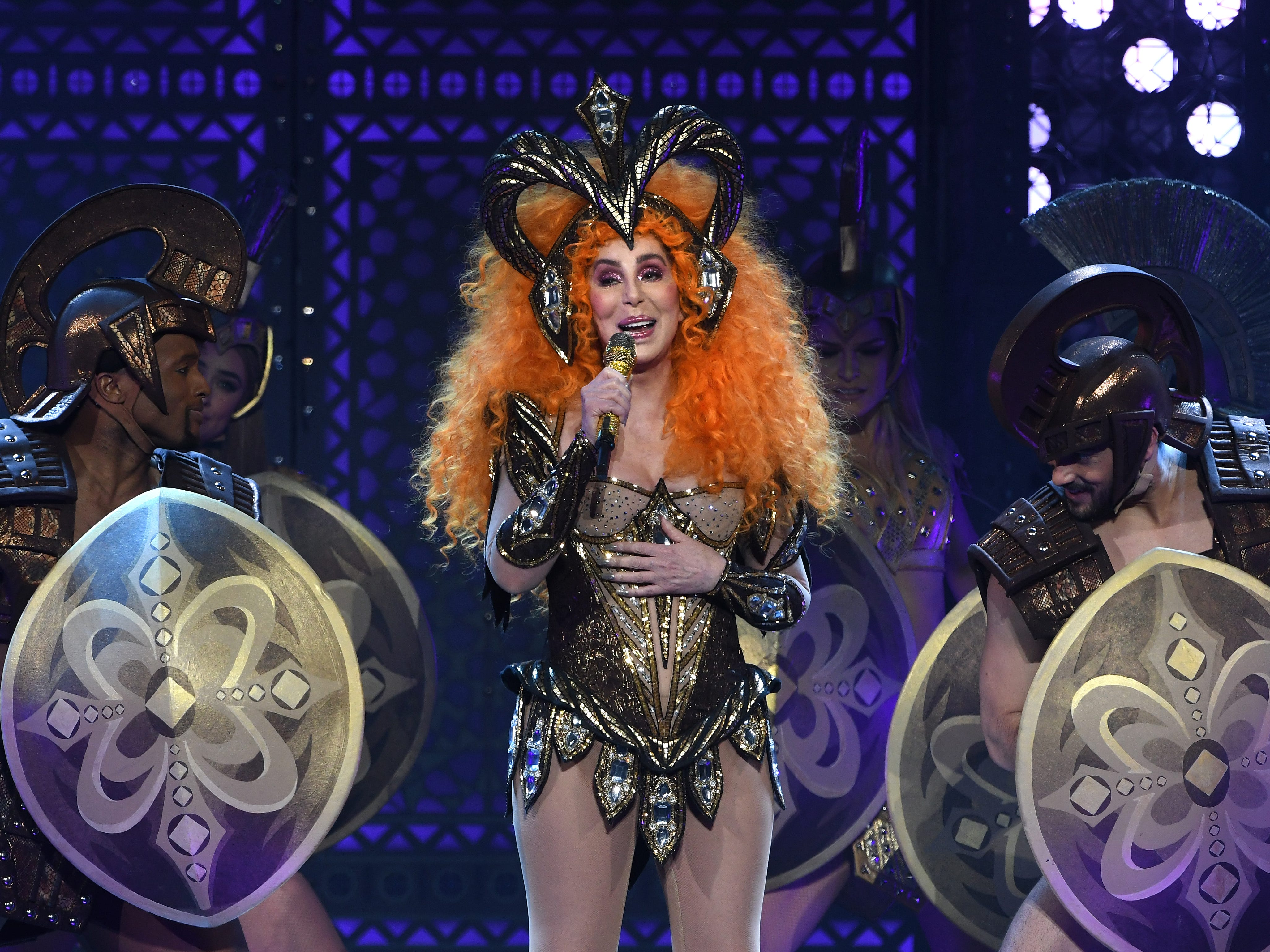 Cher turns back time to the delight of the audience, performing at Little Caesars Arena in Detroit.