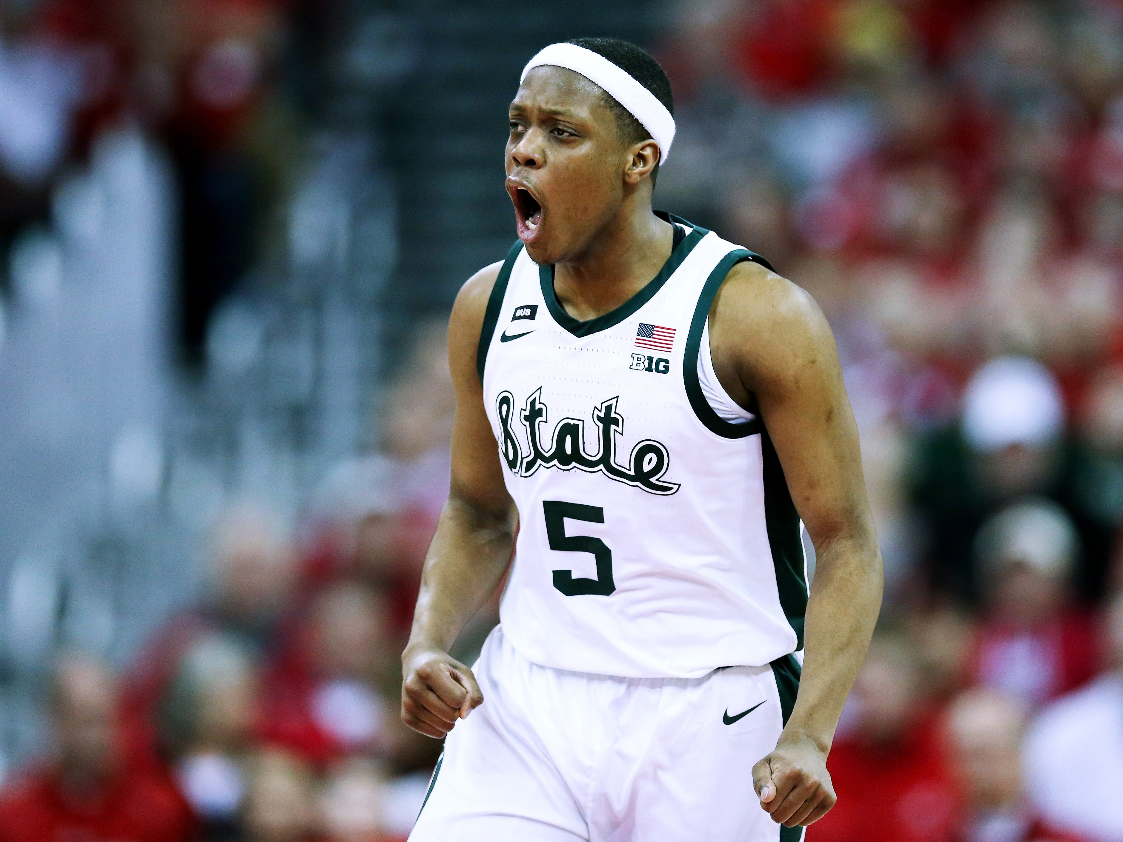 Michigan State's Cassius Winston reacts in the first half against Wisconsin.