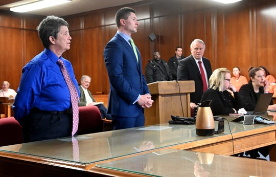 Nikki Joly, left, transgender activist, and defense attorney Daniel Barnett, center, face Judge John McBain in circuit court in Jackson on Friday, Feb 1, 2019.  Joly is charged with arson in connection with a fire in his home that killed five pets.