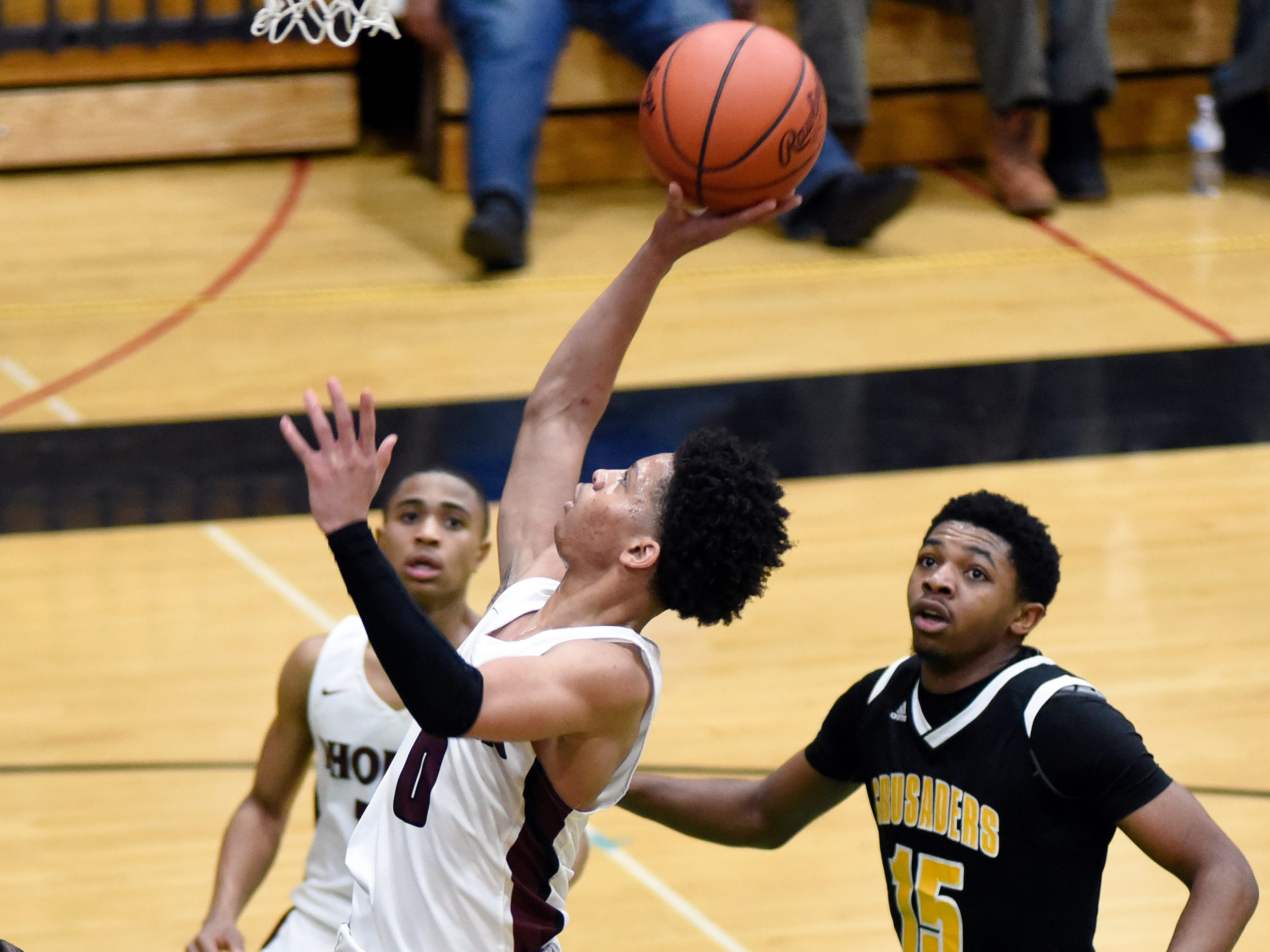 Detroit Renaissance's Keon Henderson (0) goes up for a basket against Detroit King during the fourth quarter.