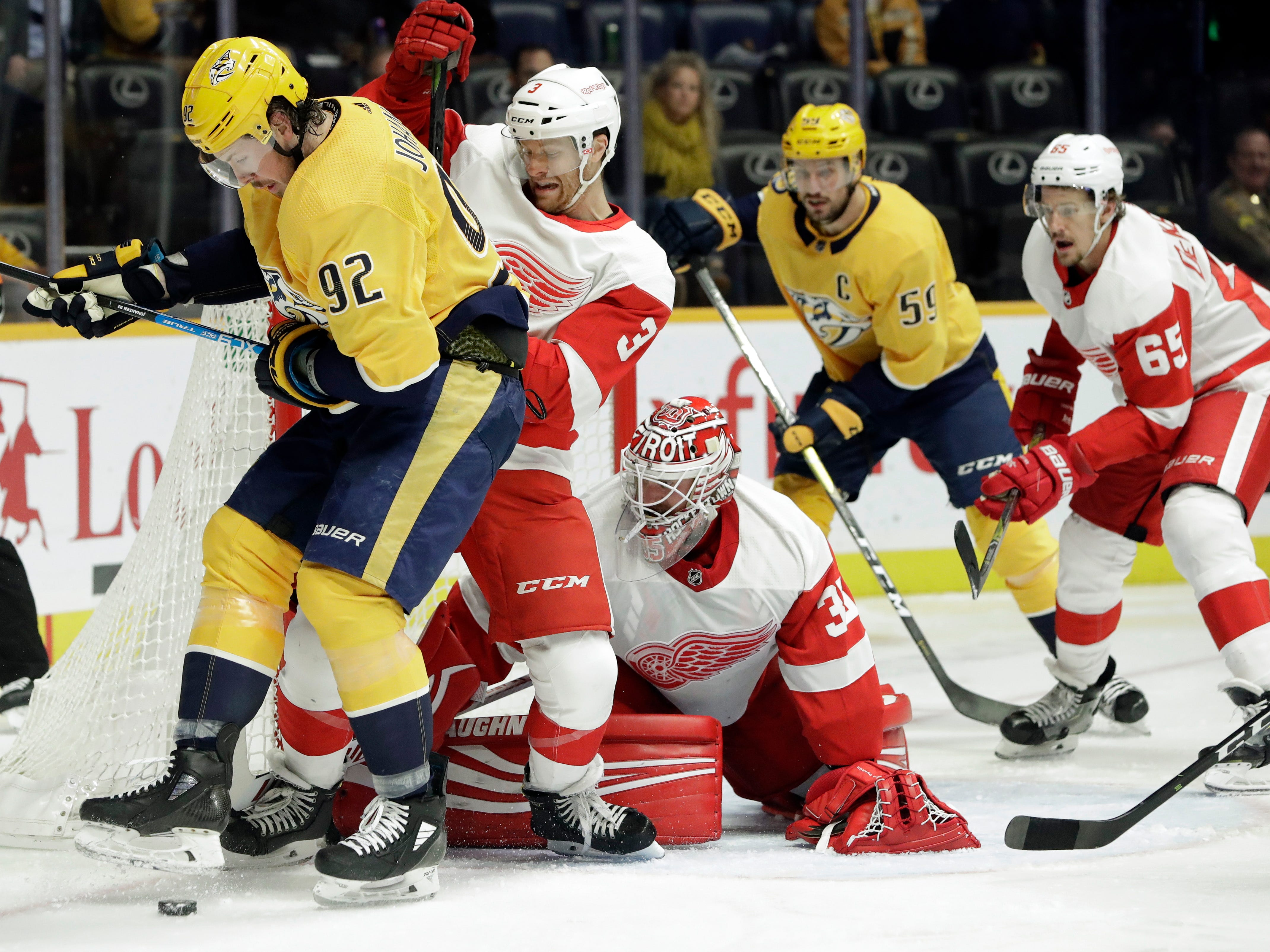 Nashville Predators center Ryan Johansen (92) and Detroit Red Wings defenseman Nick Jensen (3) compete for the puck during the second period.