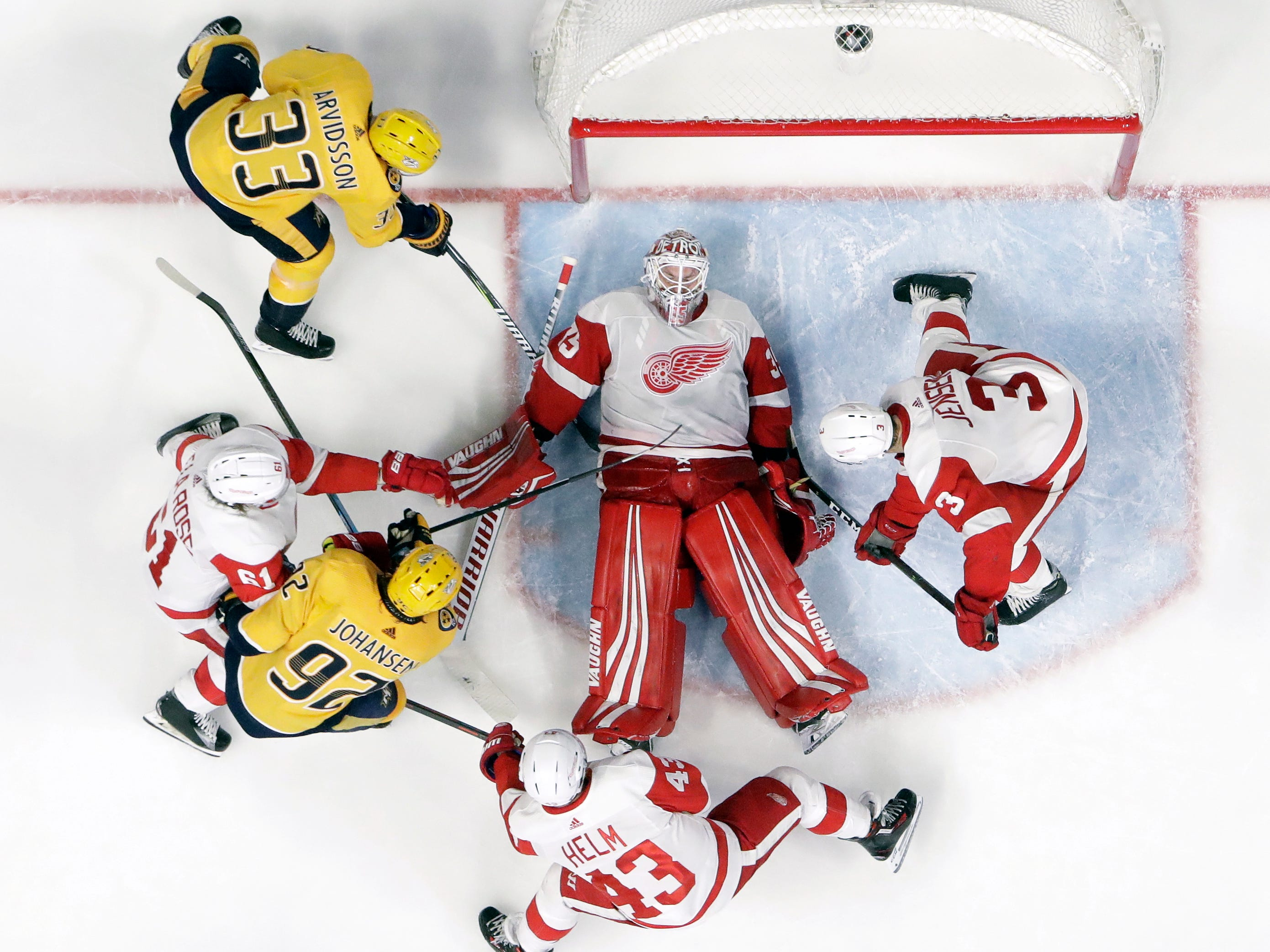 Detroit Red Wings goaltender Jimmy Howard (35) covers up the puck during the third period.