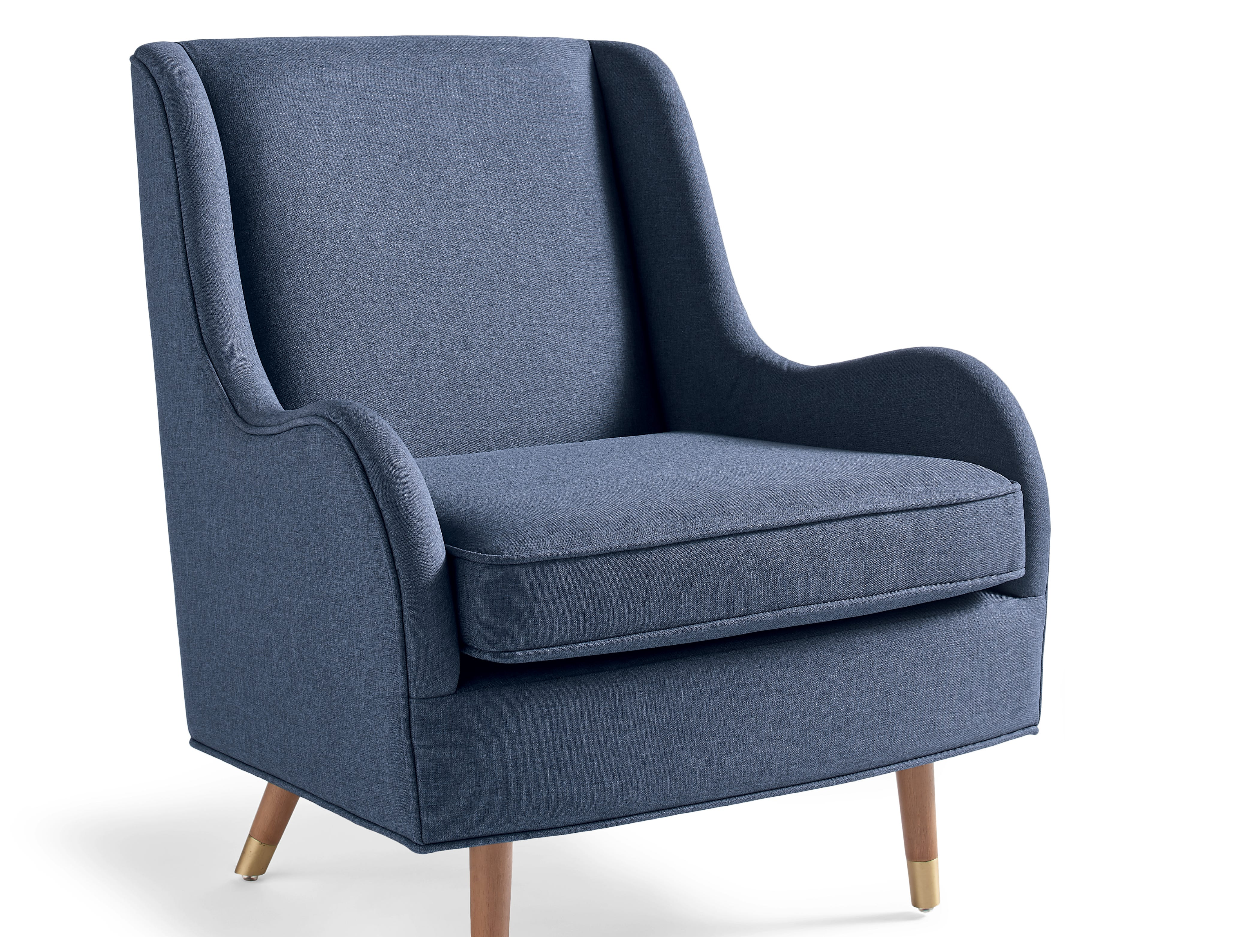 Will Taylor's new collection with Grandin Road includes the Coften Chair, upholstered in a dark grayish blue fabric.