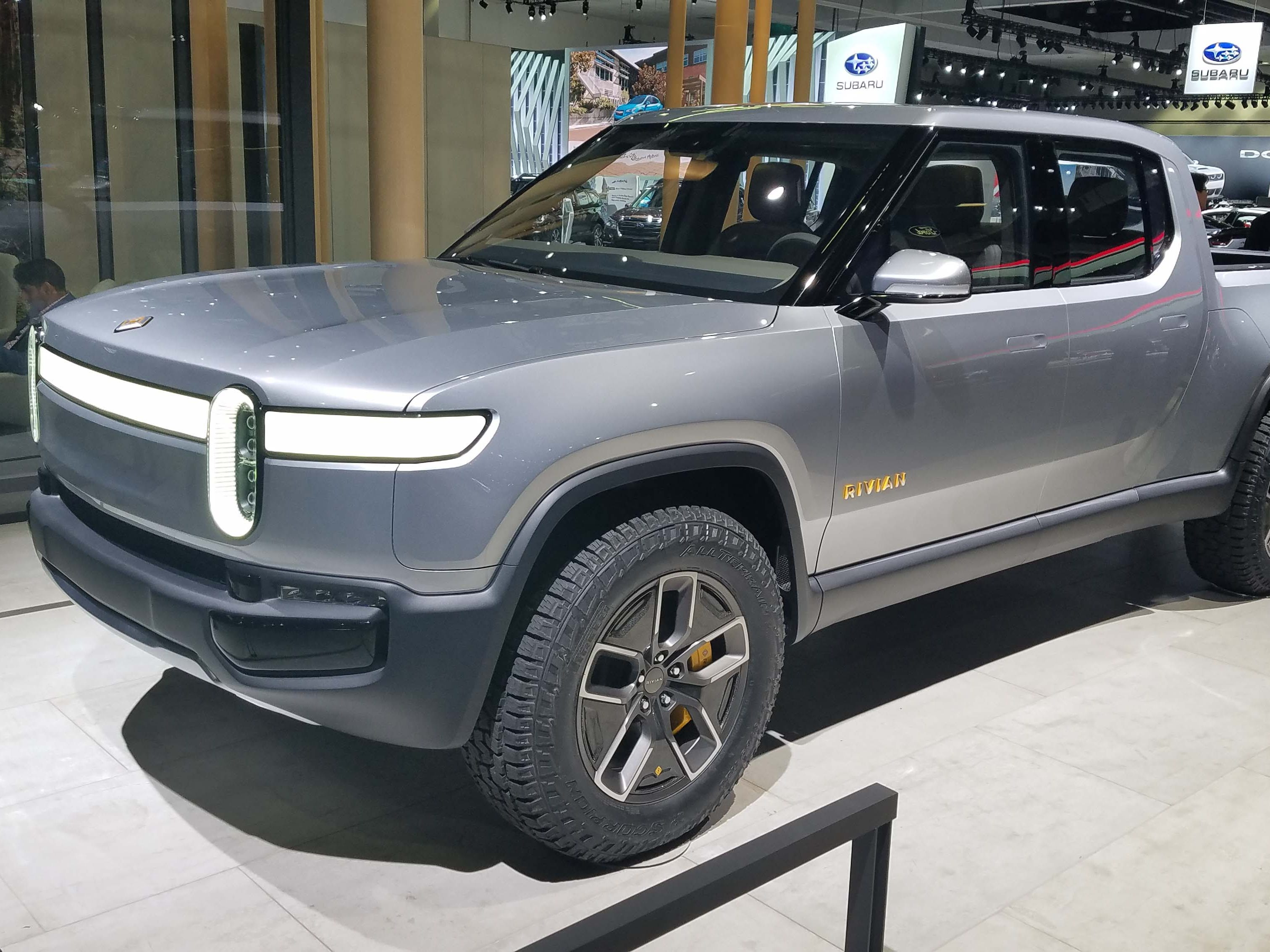 Electric truckmaker Rivian introduced the R1T pickup EV at the Los Angeles auto show last November. GM and Amazon are reportedly negotiating an investment stake in the automaker.