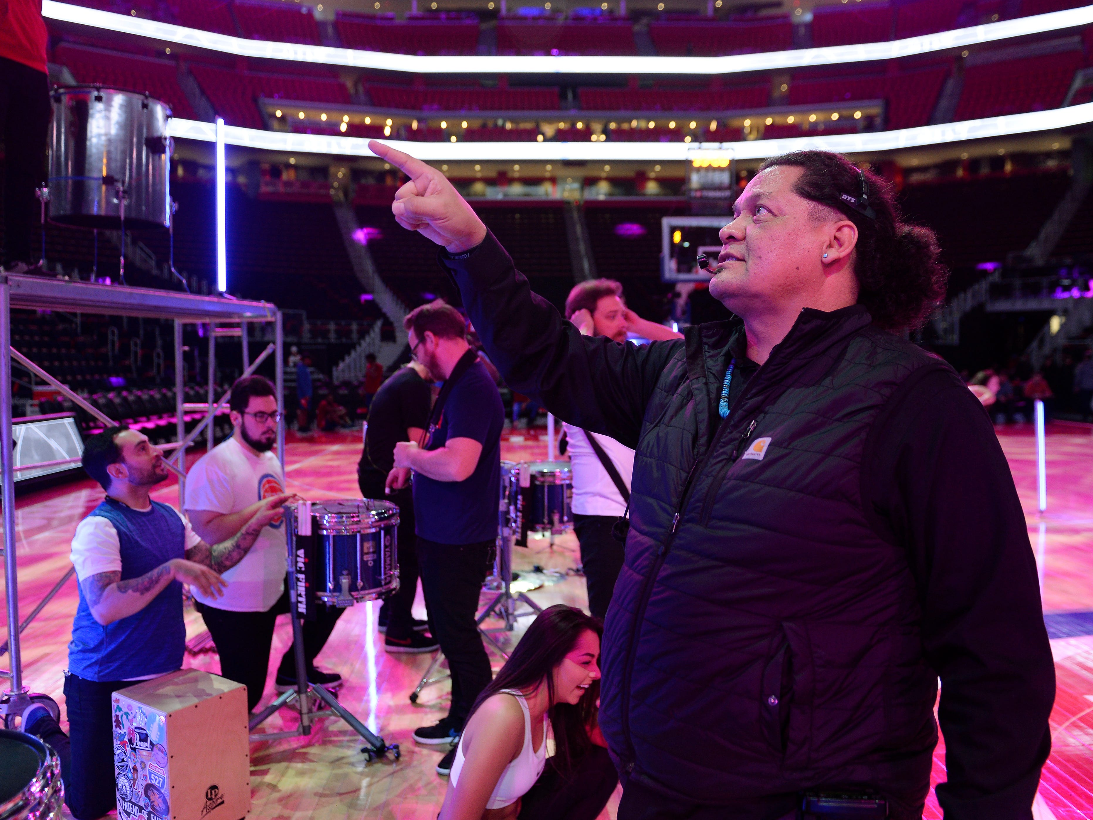 Shawn Martinez, entertainment director for the Detroit Pistons, directs the rehearsal for the halftime entertainment for the game against the Washington Wizards.