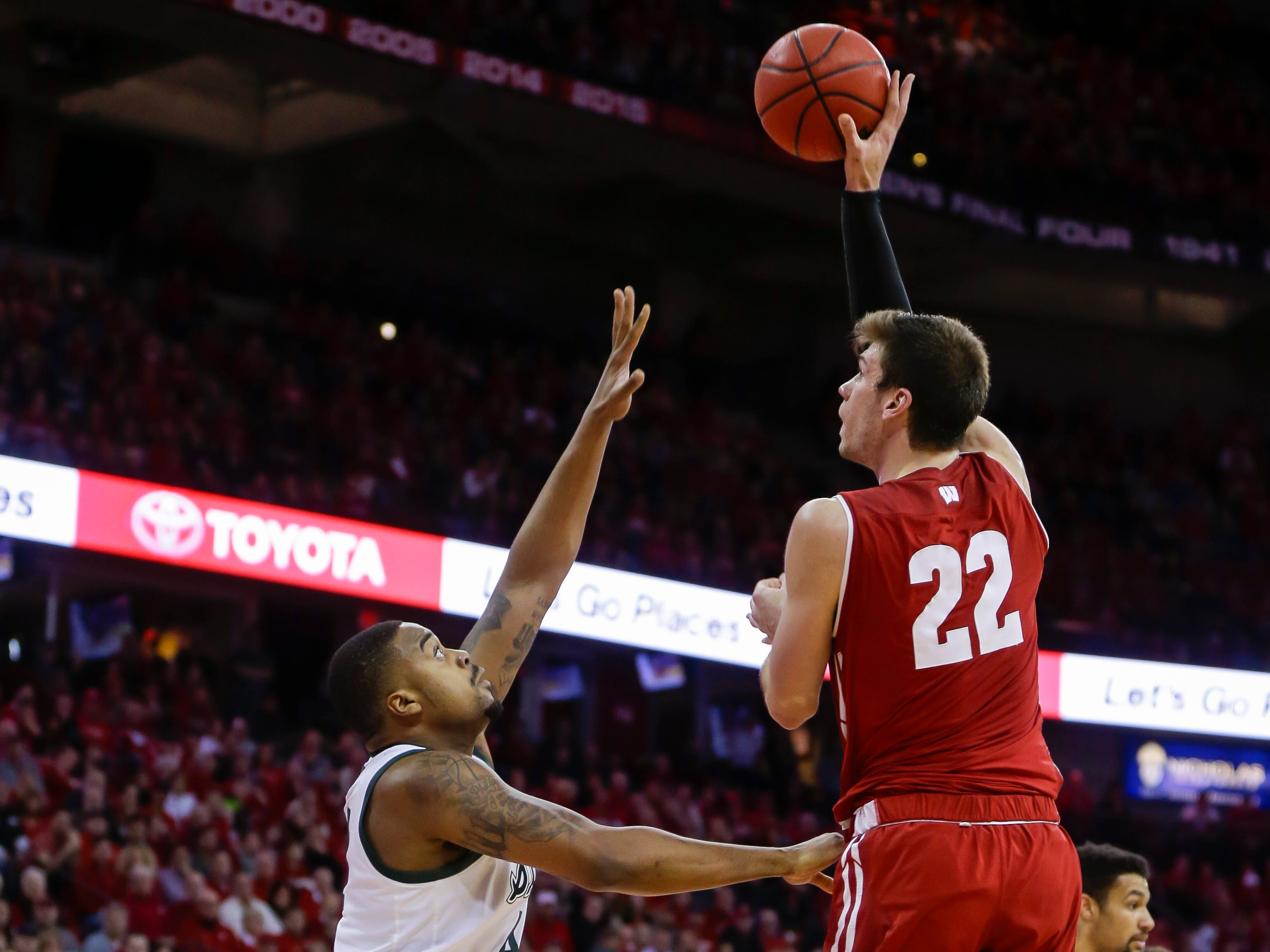 Wisconsin's Ethan Happ (22) shoots for his 2,000th career point during the second half.