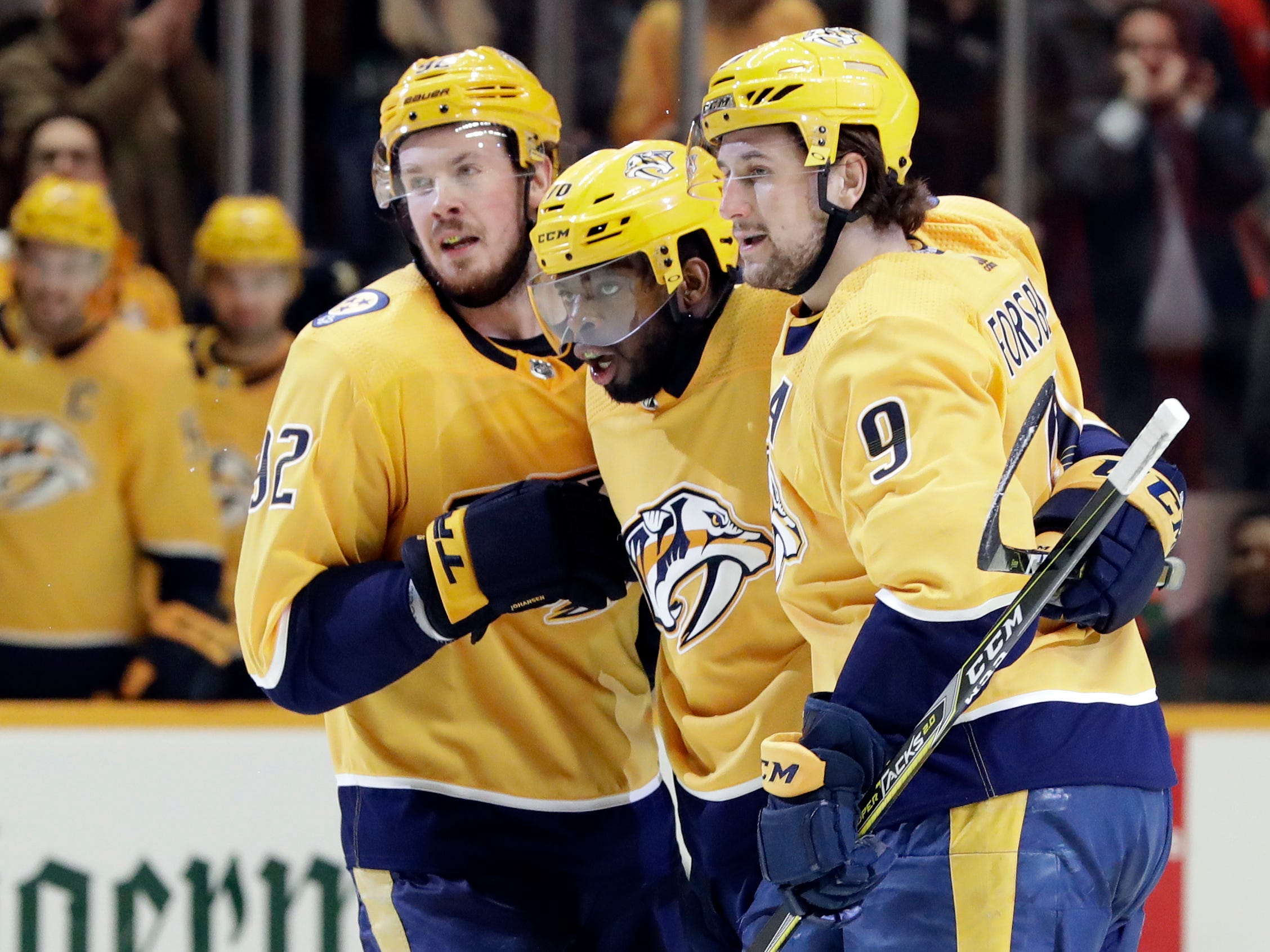 Nashville Predators defenseman P.K. Subban, center, celebrates with Ryan Johansen (92) and Filip Forsberg (9), of Sweden, after Subban scored against the Detroit Red Wings during the second period.