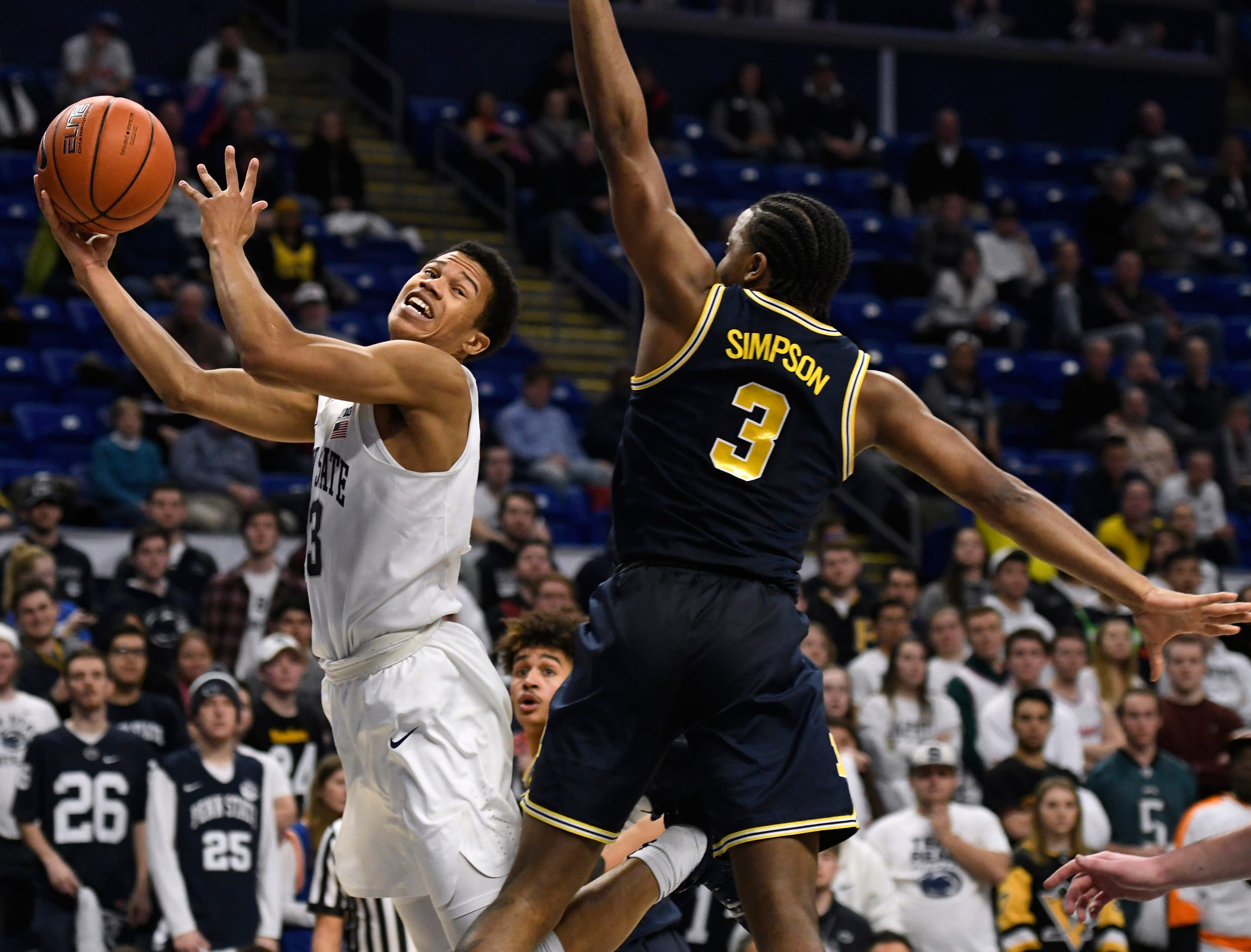 Penn State forward Satchel Pierce (3) shoots past Michigan guard Zavier Simpson (3) during the second half of an NCAA college basketball game Tuesday, Feb. 12, 2019, in State College, Pa. Penn State won 75-69. (AP Photo/John Beale)