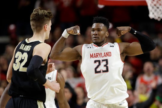 Maryland forward Bruno Fernando (23) gestures in front of Purdue center Matt Haarms during the second half Tuesday. Fernando contributed 12 points to Maryland's 70-56 win.