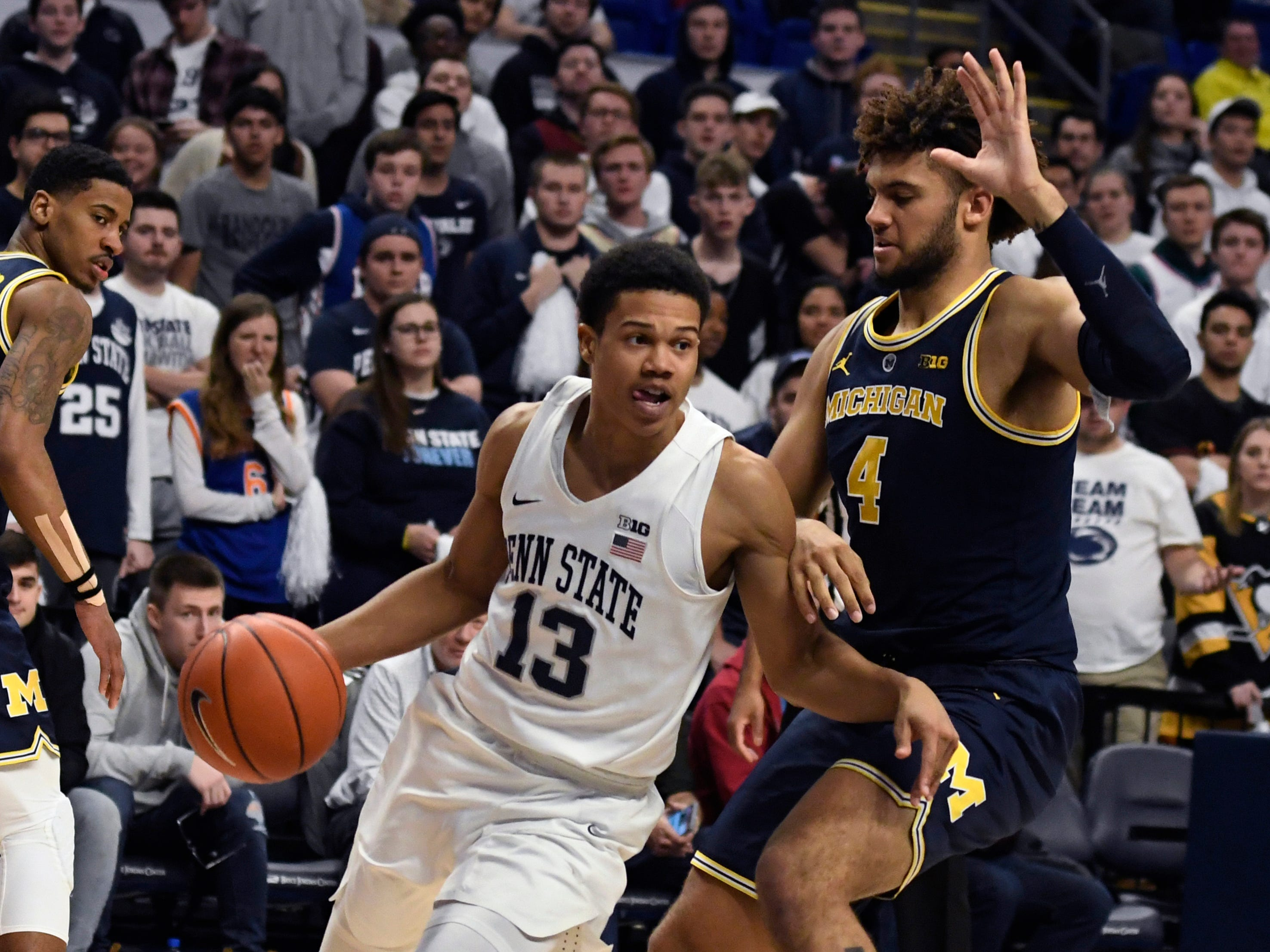 Penn State guard Rasir Bolton (13) dribbles past Michigan forward Isaiah Livers (4) during the second half.