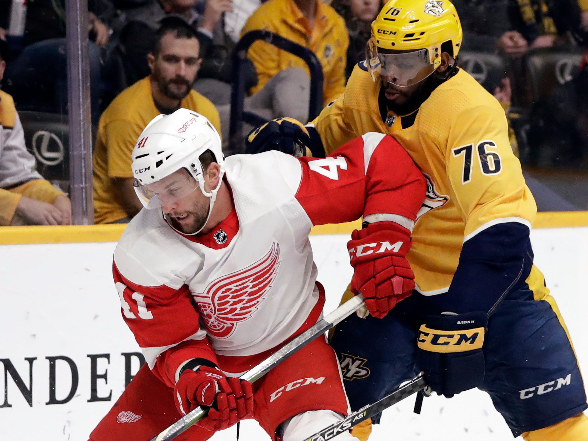 Detroit Red Wings center Luke Glendening (41) is defended by Nashville Predators' P.K. Subban (76) during the first period.