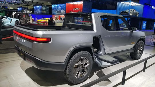 """The Rivian R1T is about the same length as a Chevy Colorado mid-size pickup. With its batteries in the floor, however, it adds storage in the """"frunk"""" as well as space behind the rear seats and under the bed."""