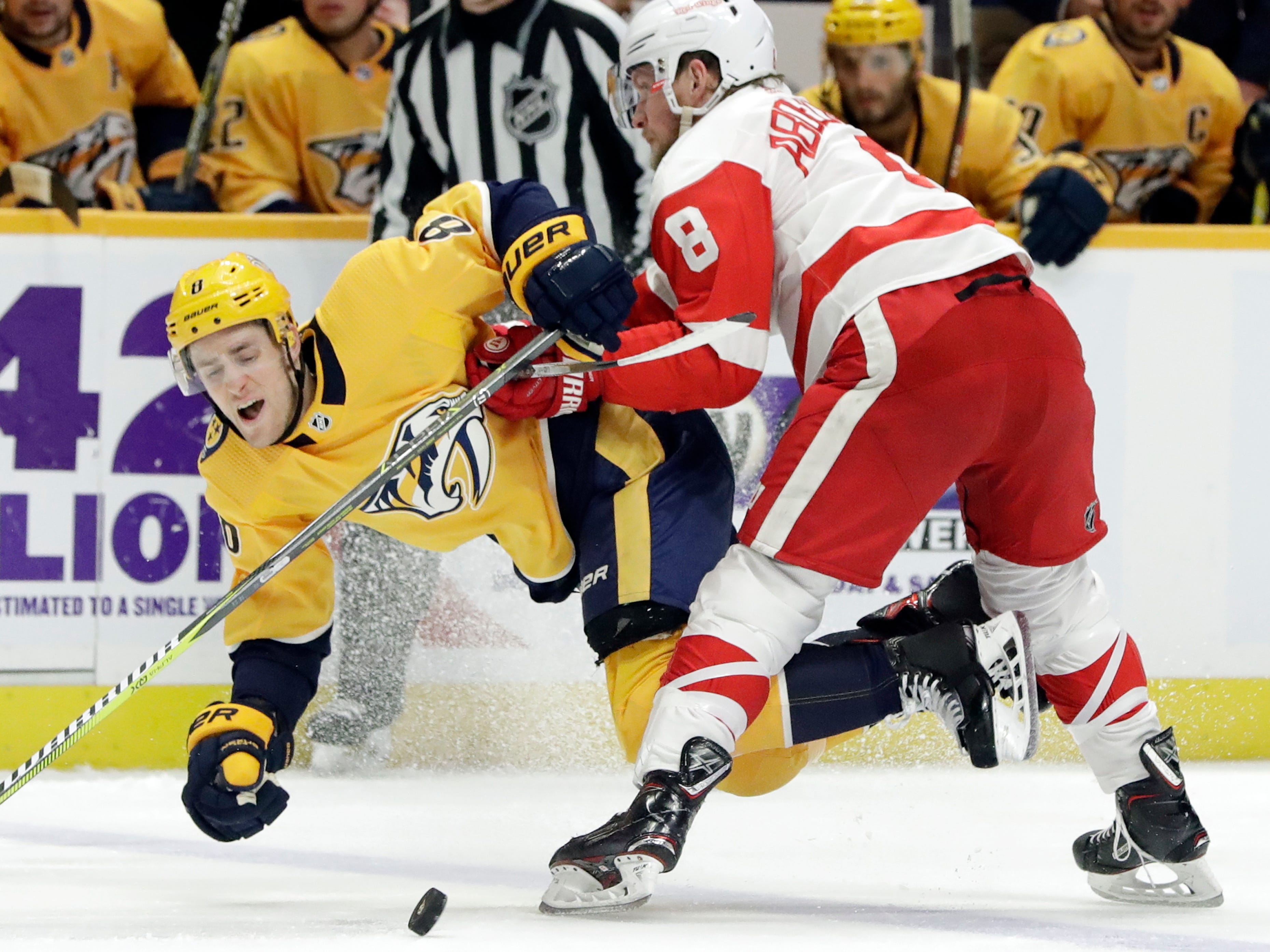 Detroit Red Wings left wing Justin Abdelkader, right, checks Nashville Predators center Kyle Turris off the puck during the second period.
