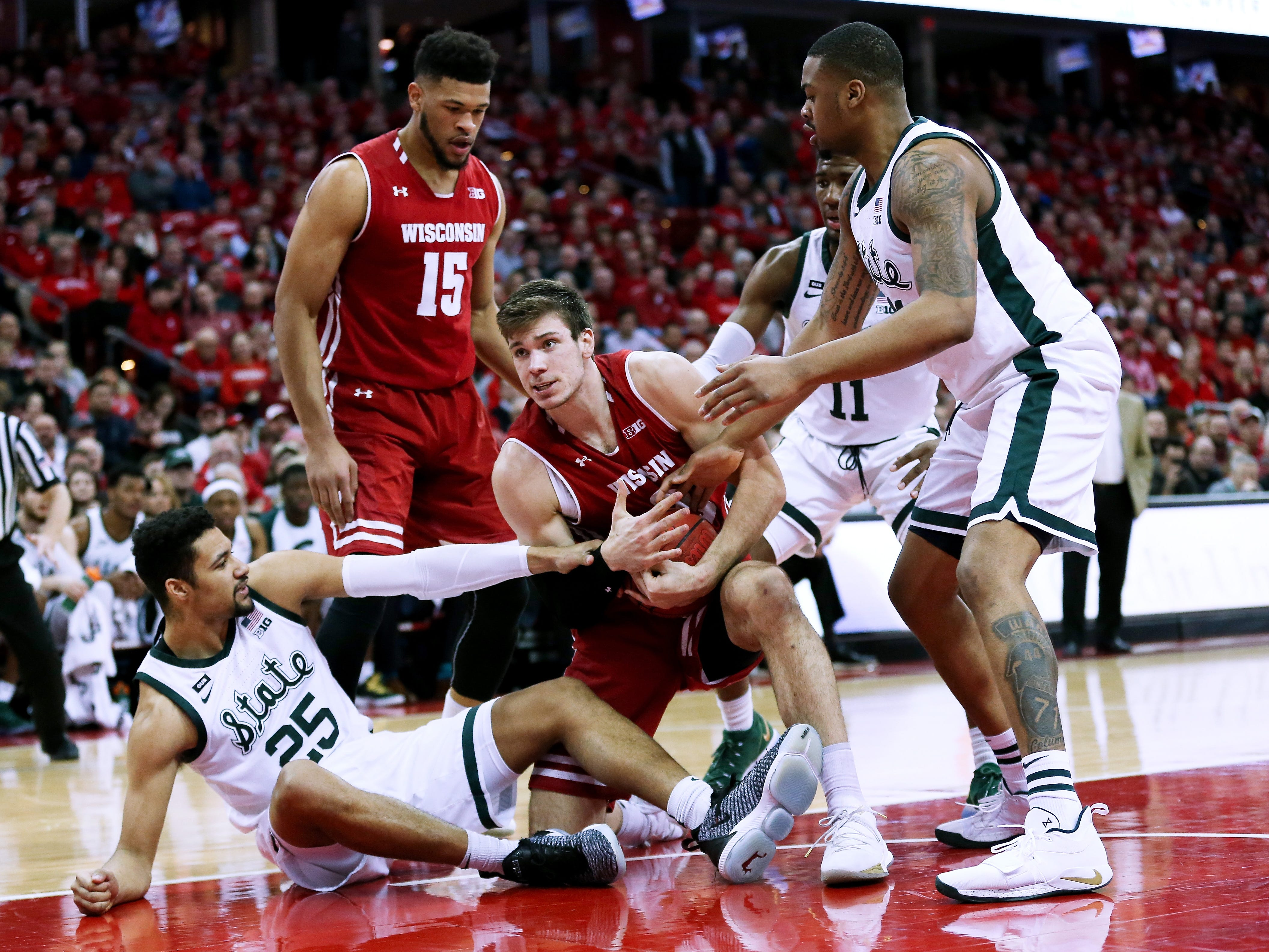 Wisconsin's Ethan Happ  calls for a timeout in the first half.