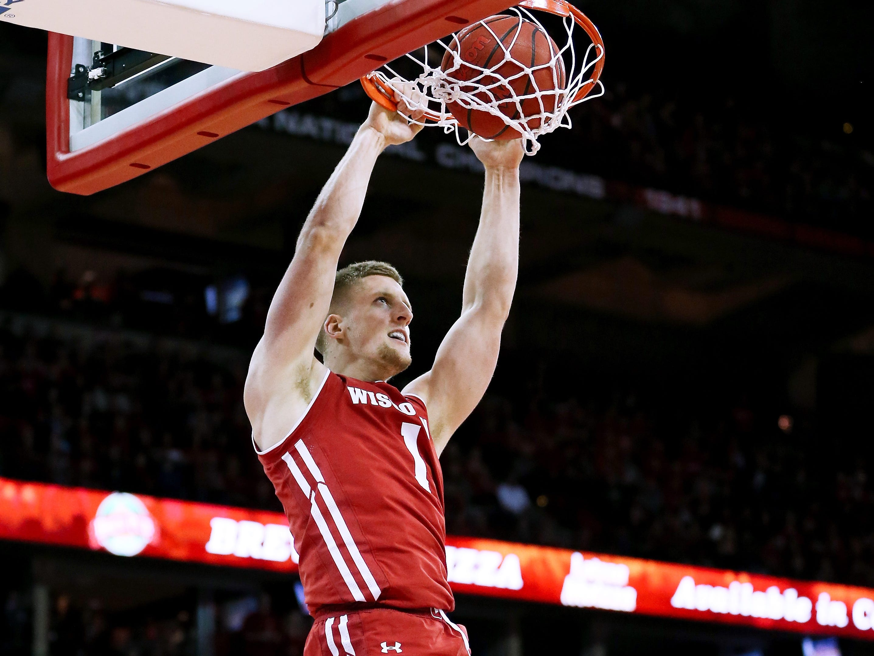 Wisconsin's Brevin Pritzl  dunks the ball in the first half.