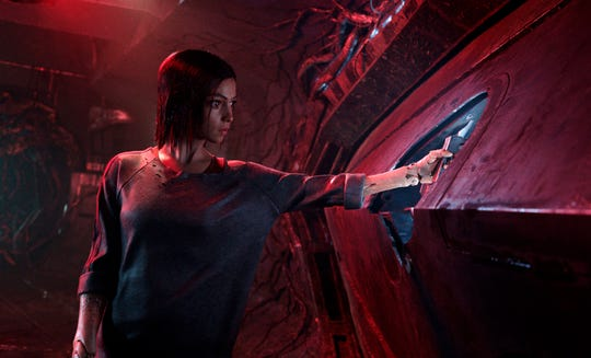"""This image released by Twentieth Century Fox shows the character Alita, voiced by Rosa Salazar, in a scene from """"Alita: Battle Angel."""""""