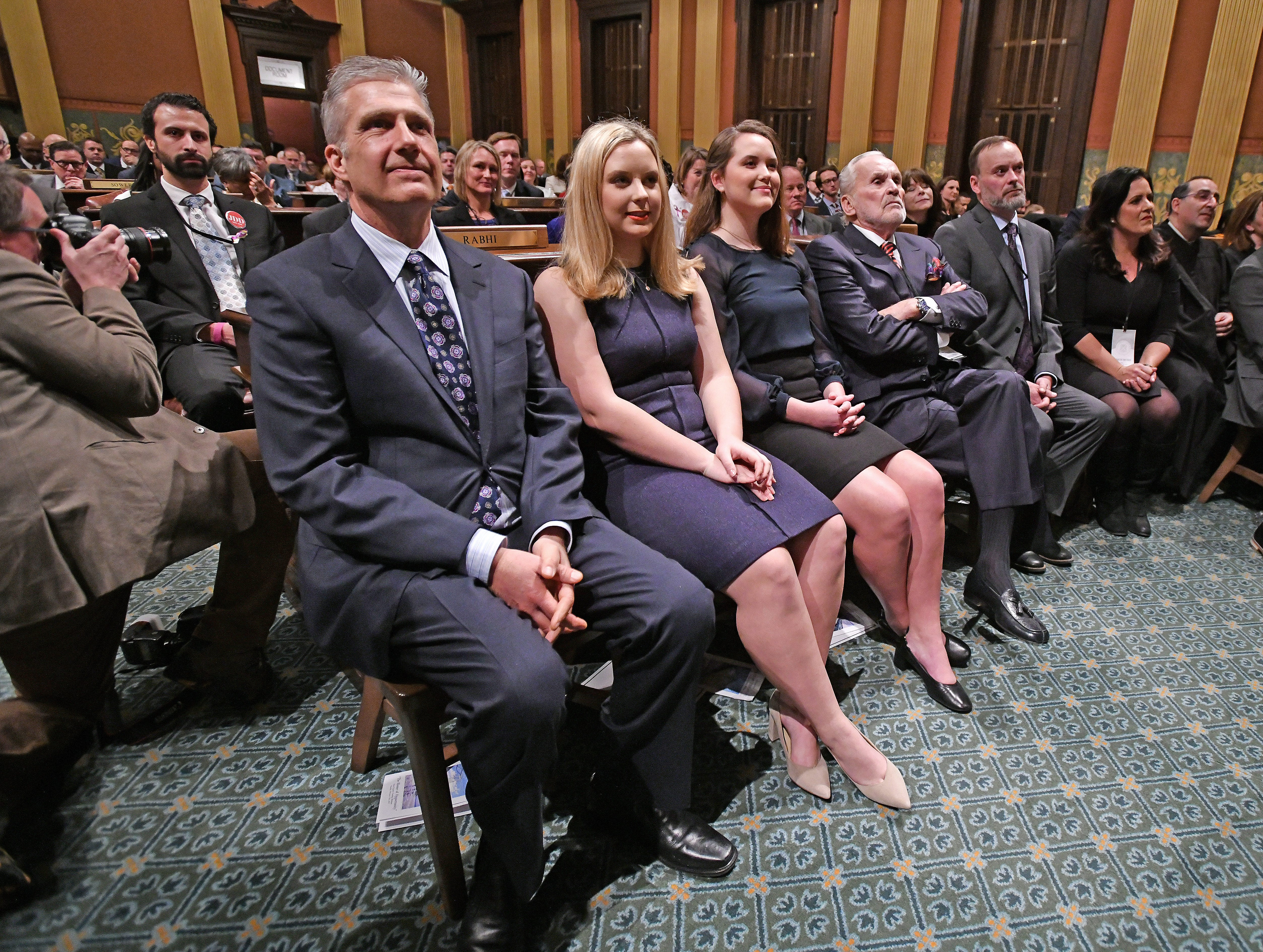 Gov. Gretchen Whitmer's husband, Dr. Marc Mallory, and daughters Sherry Schrewsbury and Sydney Schrewsbury listen to her State of the State speech.