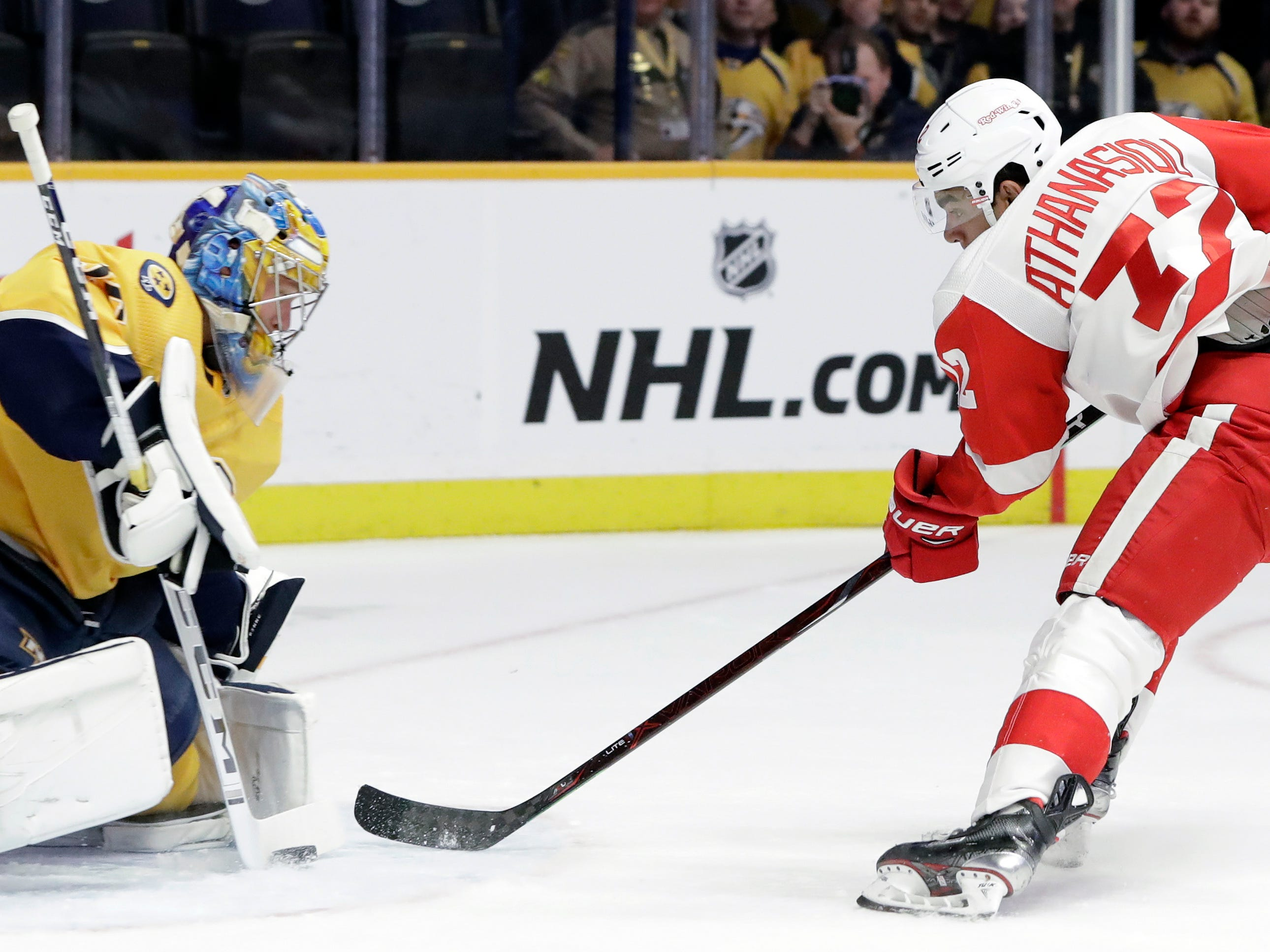 Detroit Red Wings center Andreas Athanasiou (72) shoots against Nashville Predators goaltender Pekka Rinne (35), of Finland, during the first period.