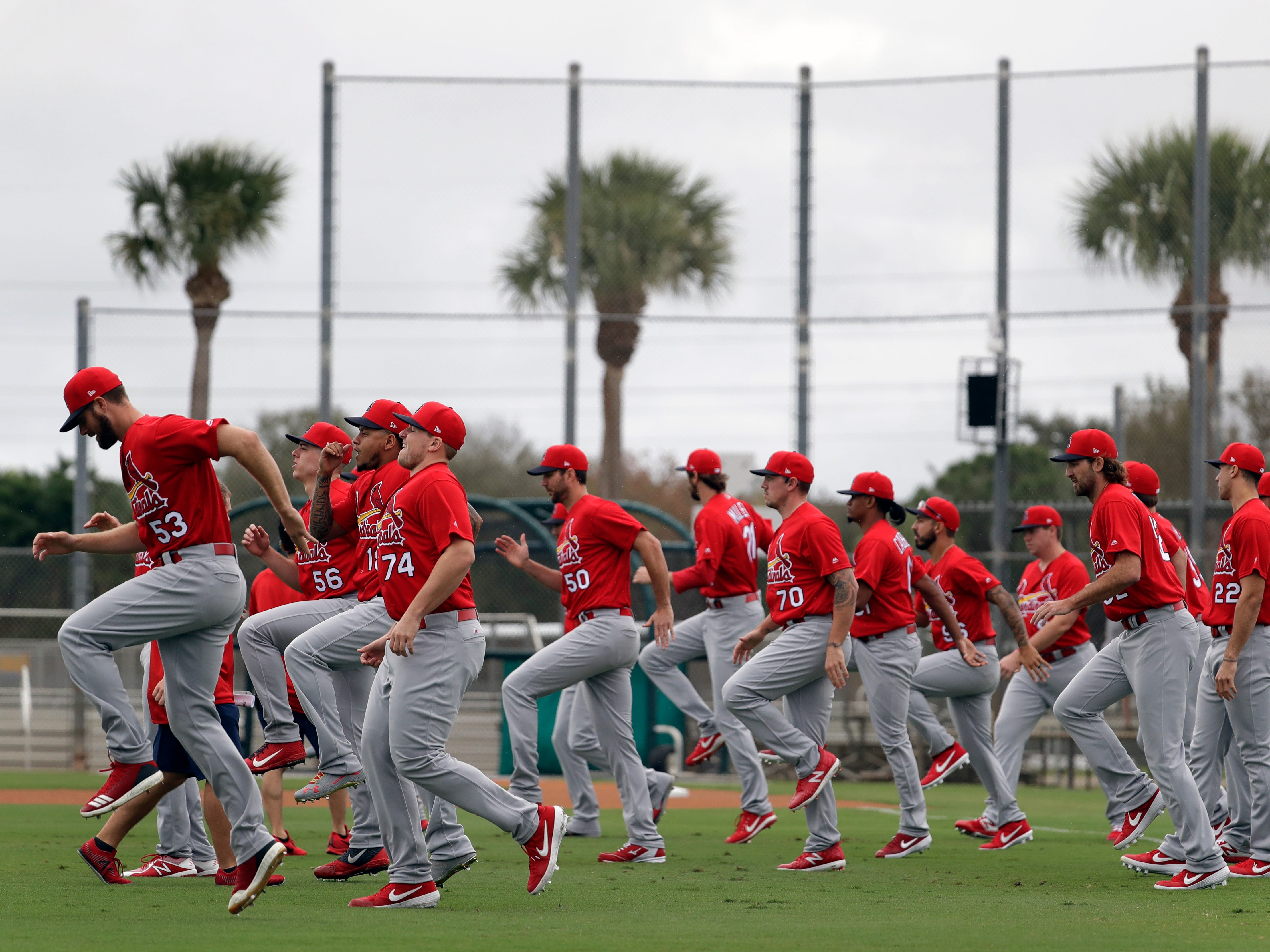 St. Louis Cardinals pitchers warm up at the start of spring training baseball practice Wednesday, Feb. 13, 2019, in Jupiter, Fla.
