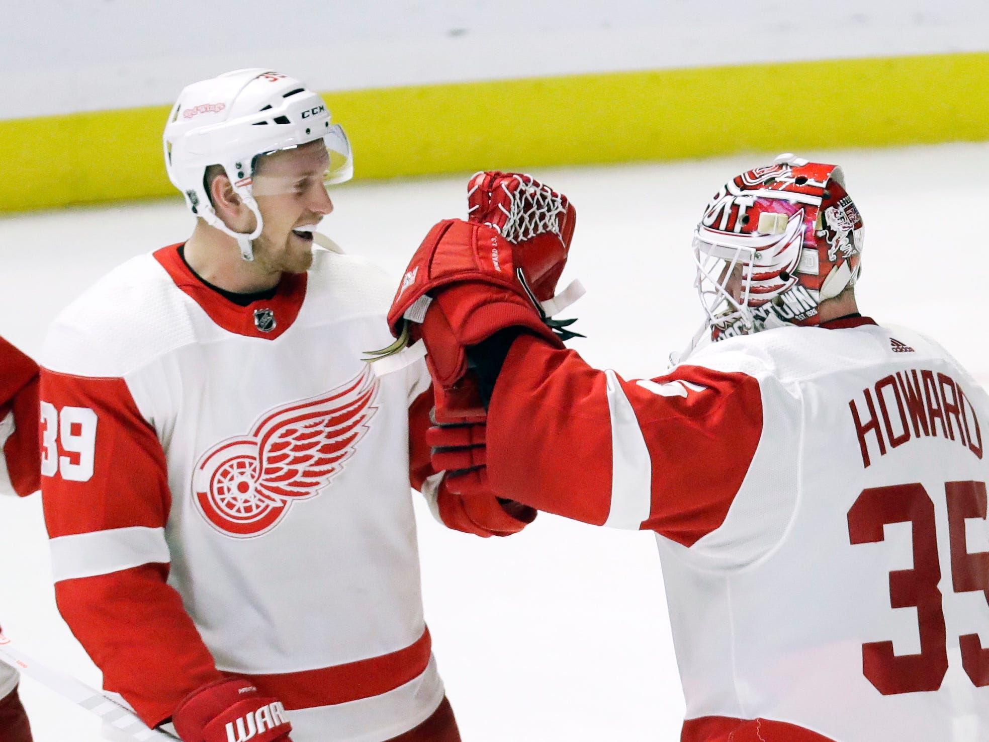 Detroit Red Wings defenseman Mike Green (25) and right wing Anthony Mantha (39) congratulate goaltender Jimmy Howard (35) after the Red Wings defeated the Nashville Predators 3-2.