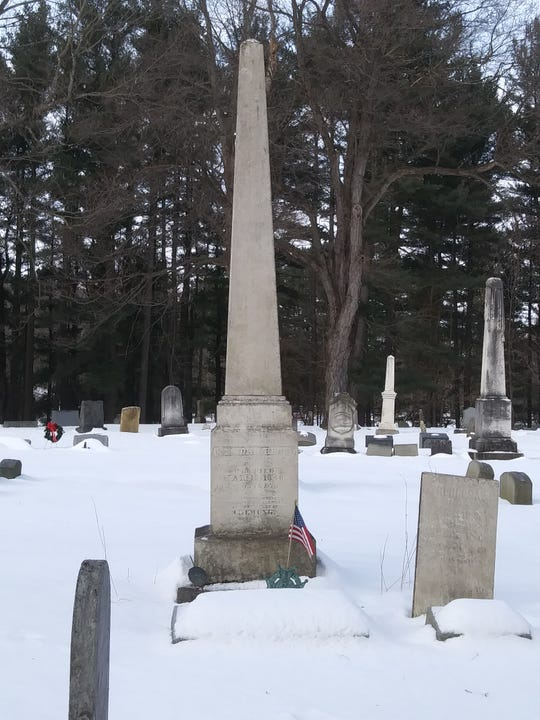 The grave of Col. John Hendy, the first man buried at Woodlawn Cemetery, in 1858.