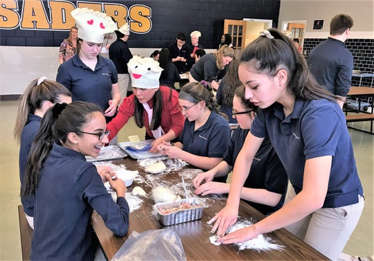 Notre Dame High School students wrap up their Chinese New Year celebration Wednesday with a dumpling competition.