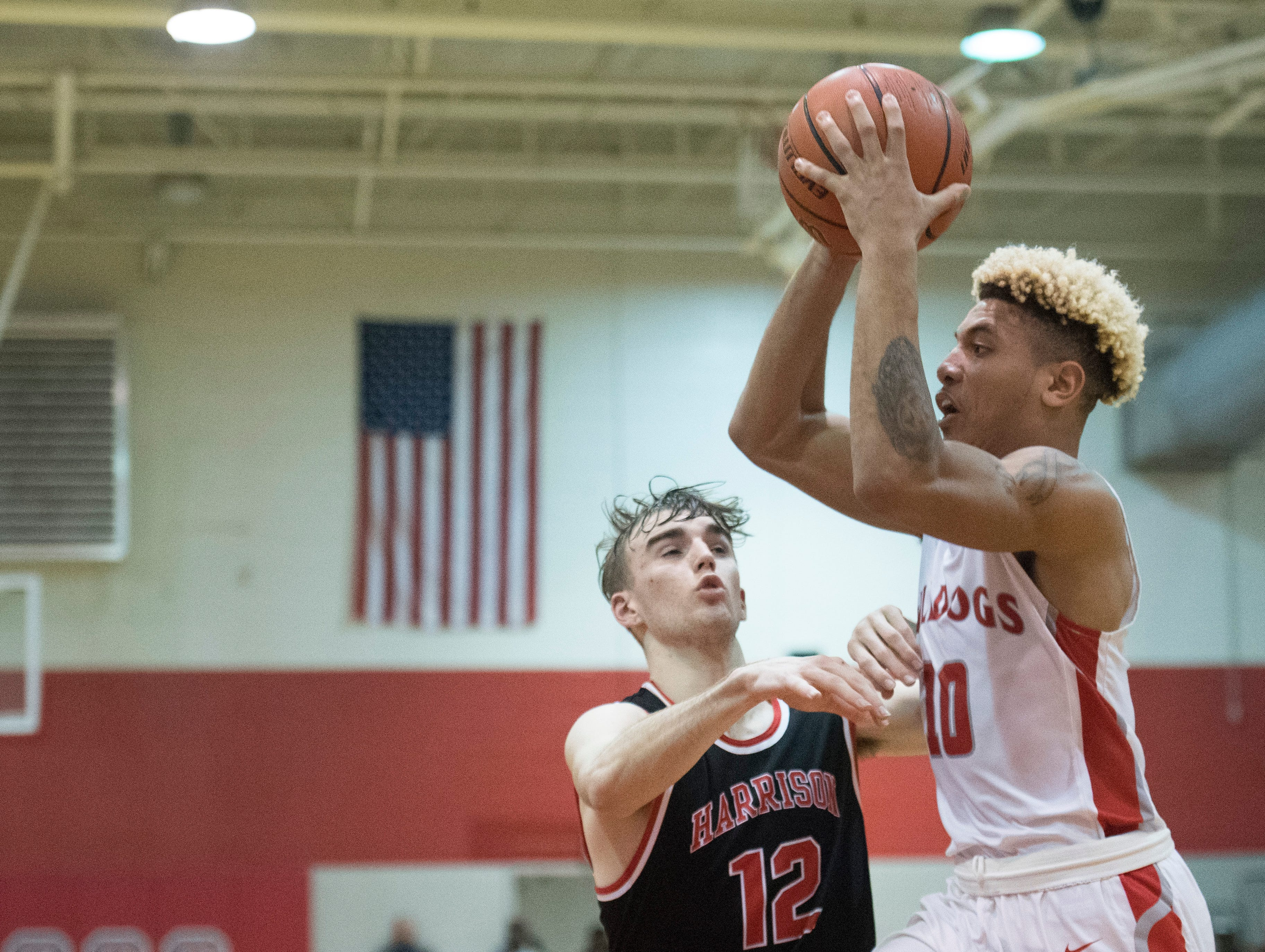Bosse's Javen Layne (10) makes a pass during the Harrison vs Bosse game at Bosse High School Tuesday, Feb. 12, 2019. The Bosse Bulldogs won 74-56.