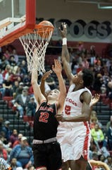 Bosse's Kiyron Powell (52) blocks Harrison's Mason Bost (12) shot during the Harrison vs Bosse game at Bosse High School Tuesday, Feb. 12, 2019. The Bosse Bulldogs won 74-56.