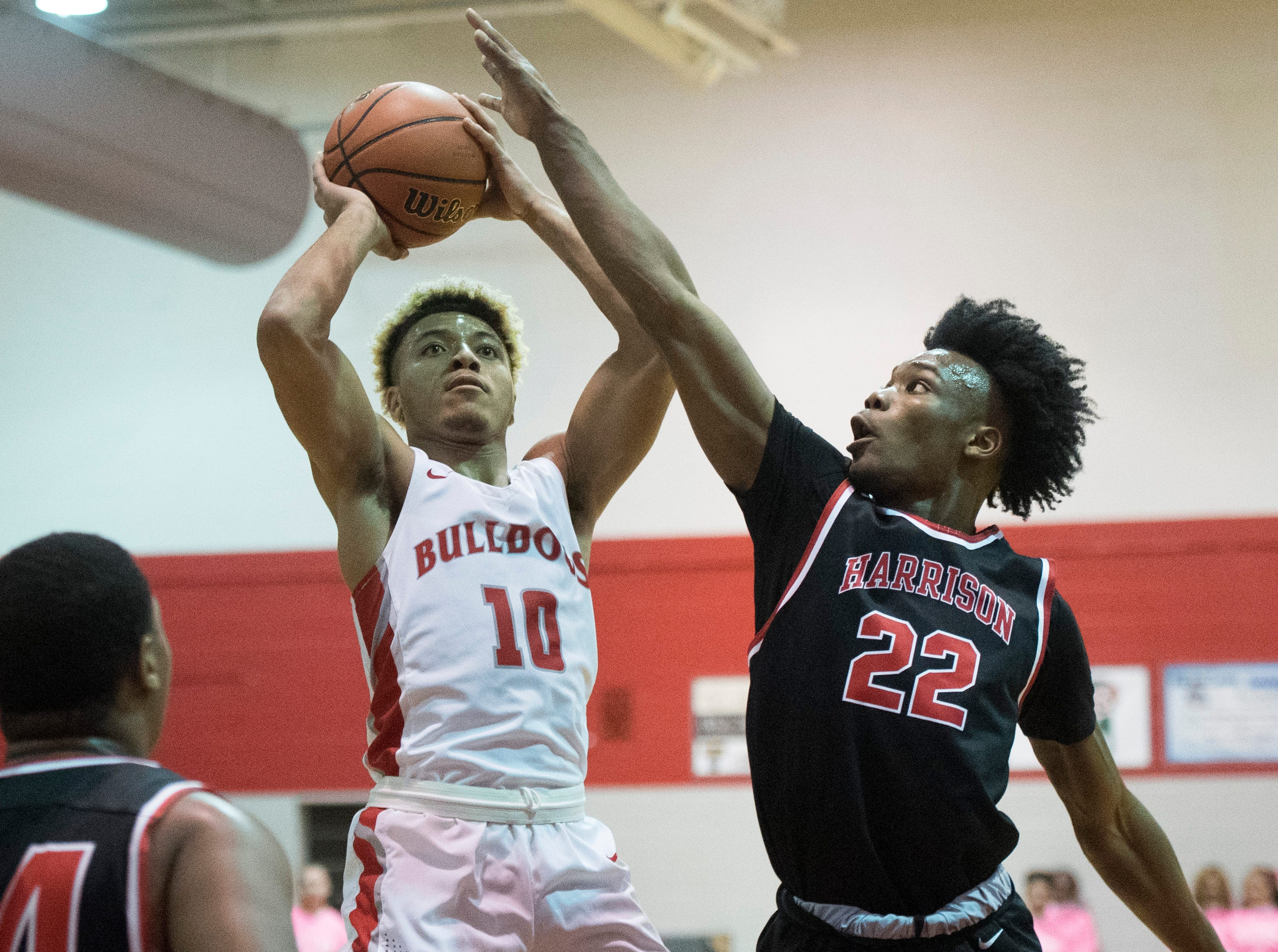 Bosse's Javen Layne (10) takes a shot during the Harrison vs Bosse game at Bosse High School Tuesday, Feb. 12, 2019.
