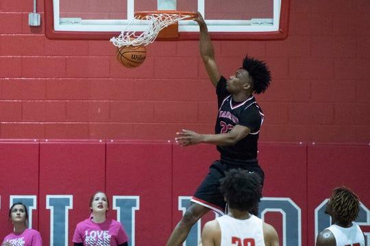Harrison's Isaiah Edinburgh (22) slam dunks during the Harrison vs Bosse game at Bosse High School Tuesday, Feb. 12, 2019.