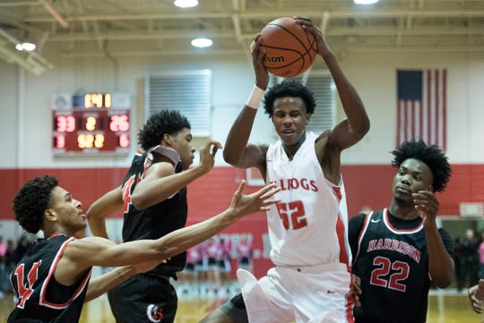 Bosse's Kiyron Powell (52) pulls down one of his 14 rebounds in the Bulldogs' 74-56 victory over Harrison Tuesday. He also had 16 points, six blocks and four assists.