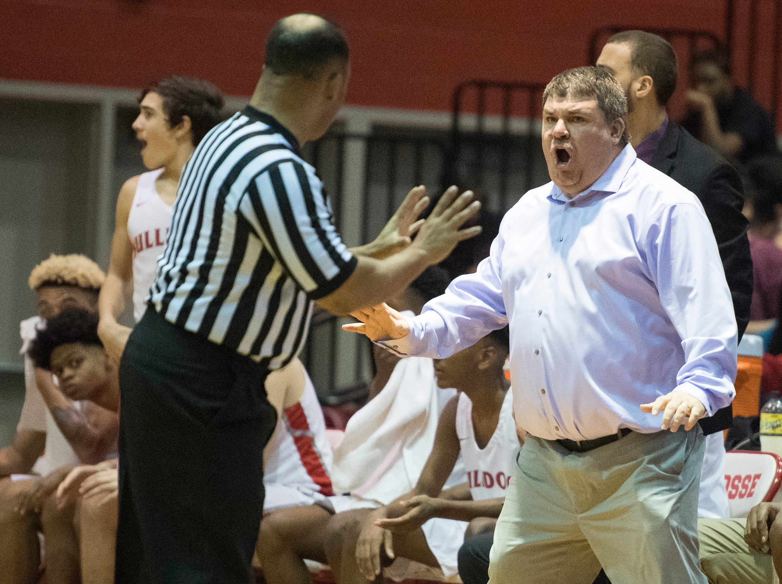 Bosse Head Coach Shane Burkhart reacts to a call during the Harrison vs Bosse game at Bosse High School Tuesday, Feb. 12, 2019.