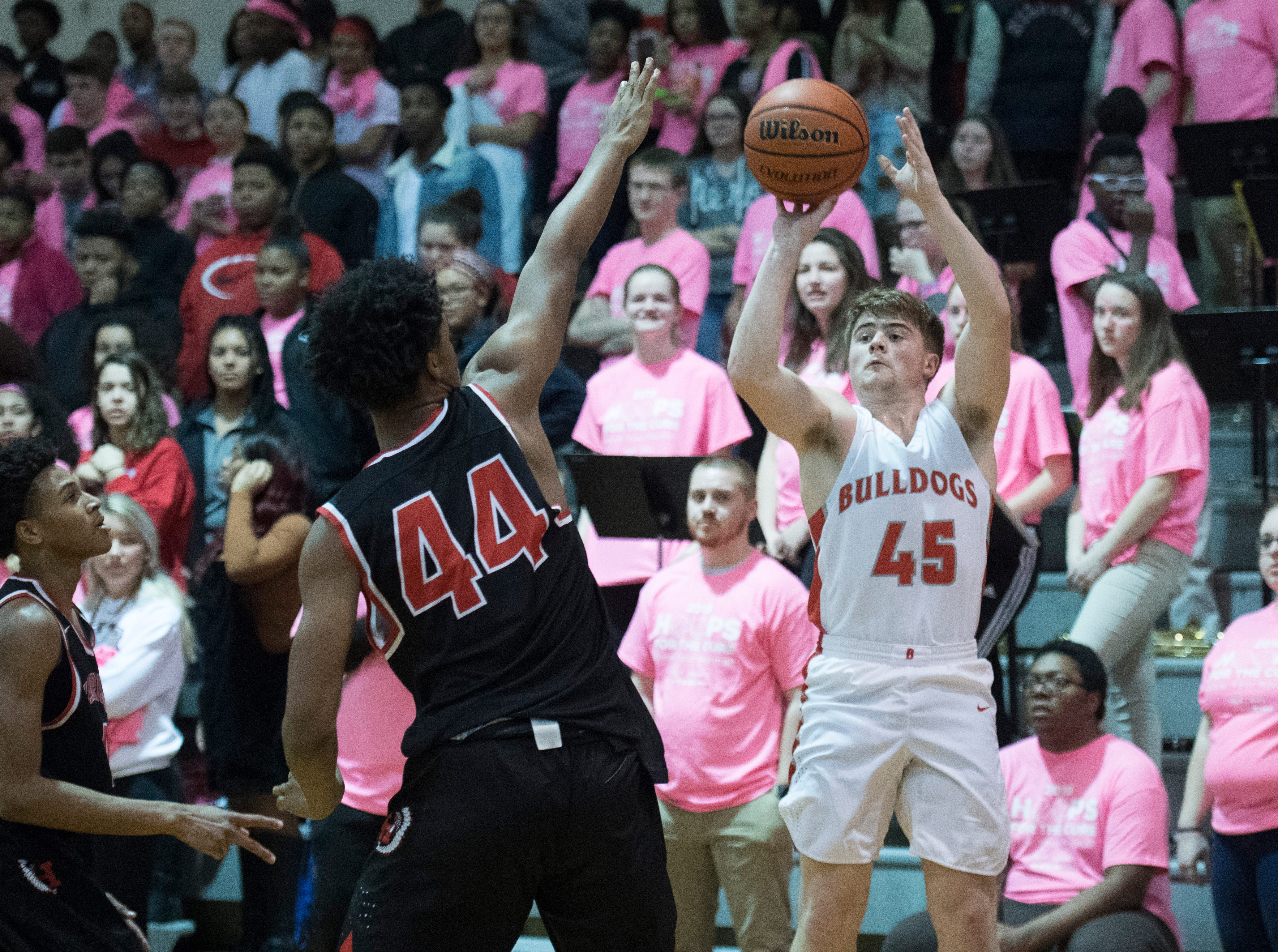 Bosse's Kolten Sanford (45) takes a 3-point shot during the Harrison vs Bosse game at Bosse High School Tuesday, Feb. 12, 2019. The Bosse Bulldogs won 74-56.