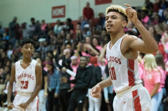 Bosse's Javen Layne (10) reacts to a foul called on the Warriors during the Harrison vs Bosse game at Bosse High School Tuesday, Feb. 12, 2019. The Bosse Bulldogs won 74-56.