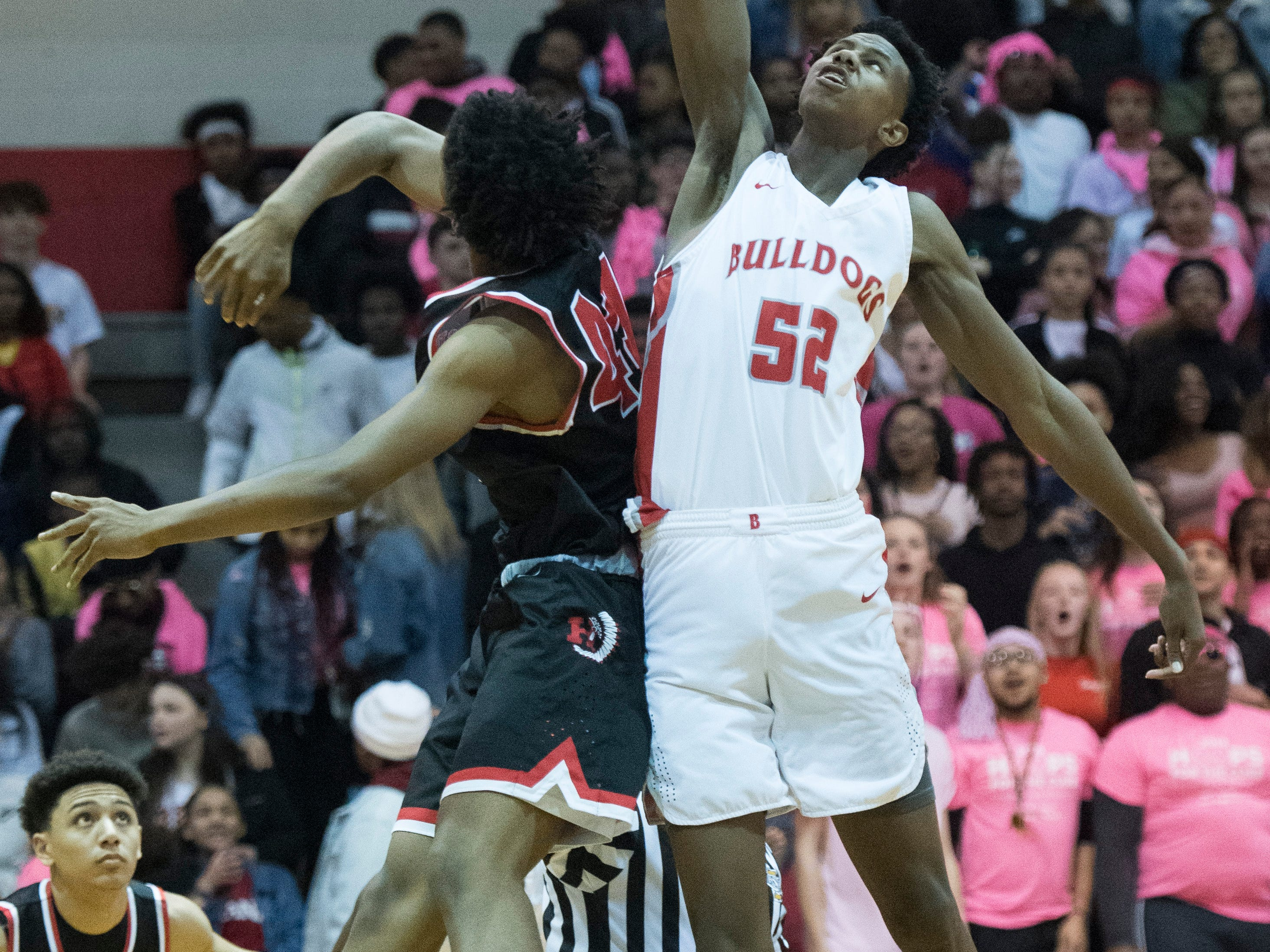 Bosse's Kiyron Powell (52) wins the tipoff to start the during the Harrison vs Bosse game at Bosse High School Tuesday, Feb. 12, 2019.