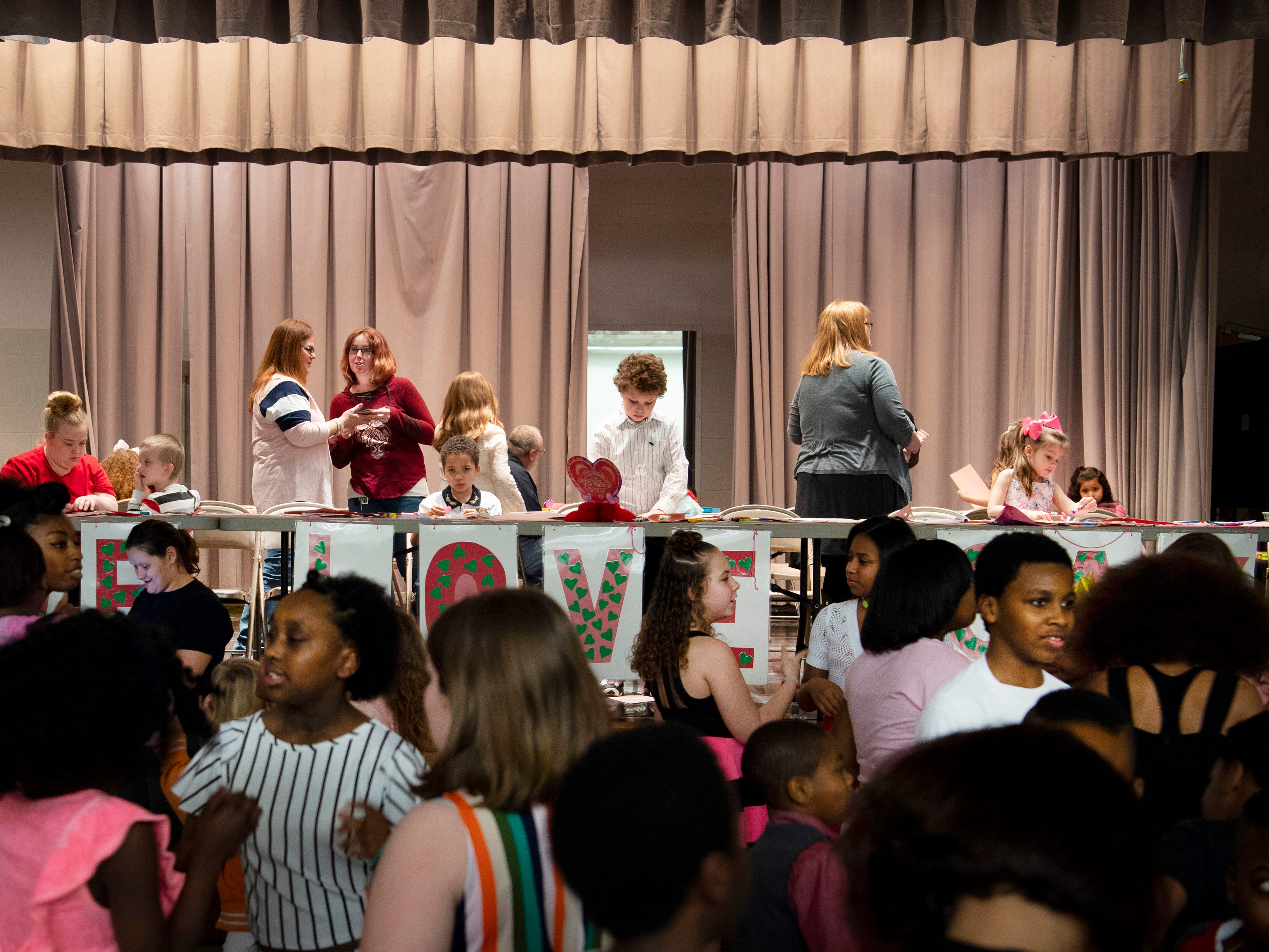 Caze Elementary School students hit the dance floor and the craft area directly after eating their dinners at the Sweetheart Dance Tuesday night.