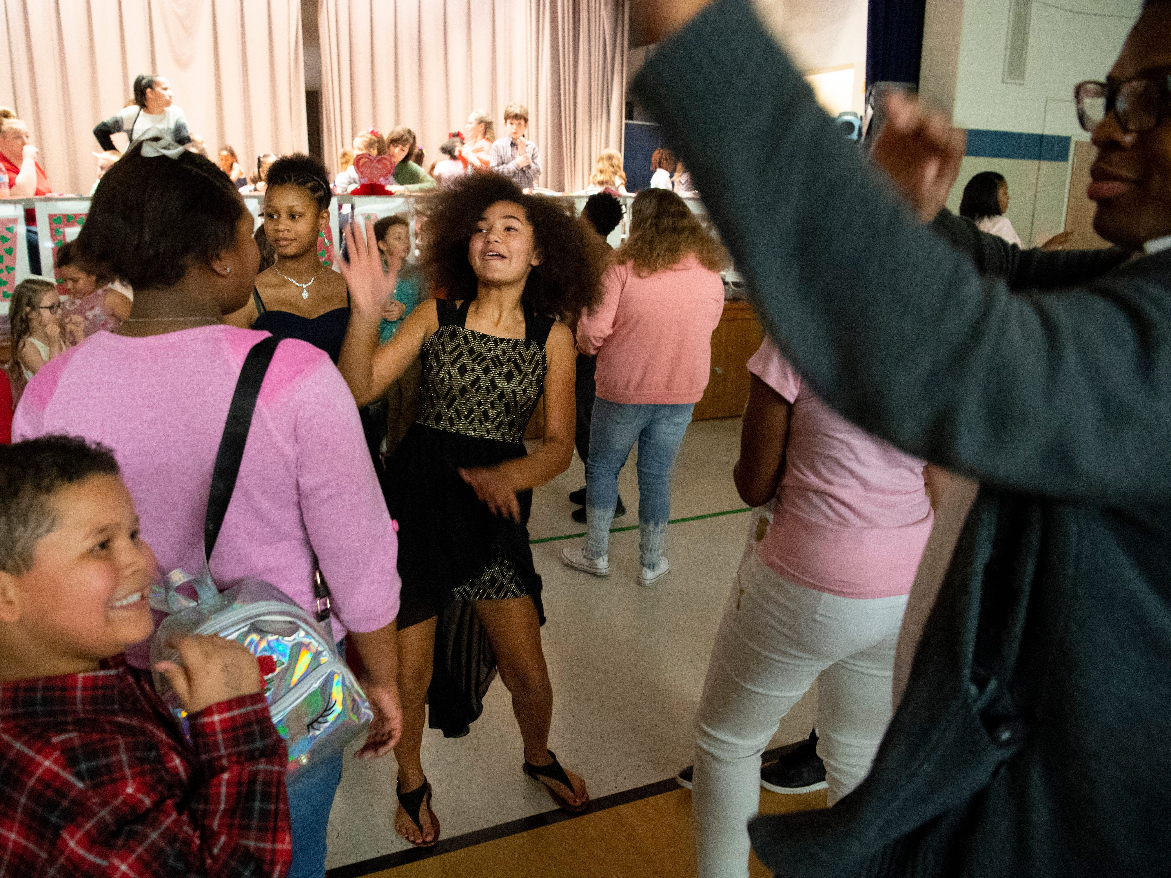 Students and their families show off a wide variety of dance moves during the Caze Elementary School Sweetheart Dance Tuesday night.