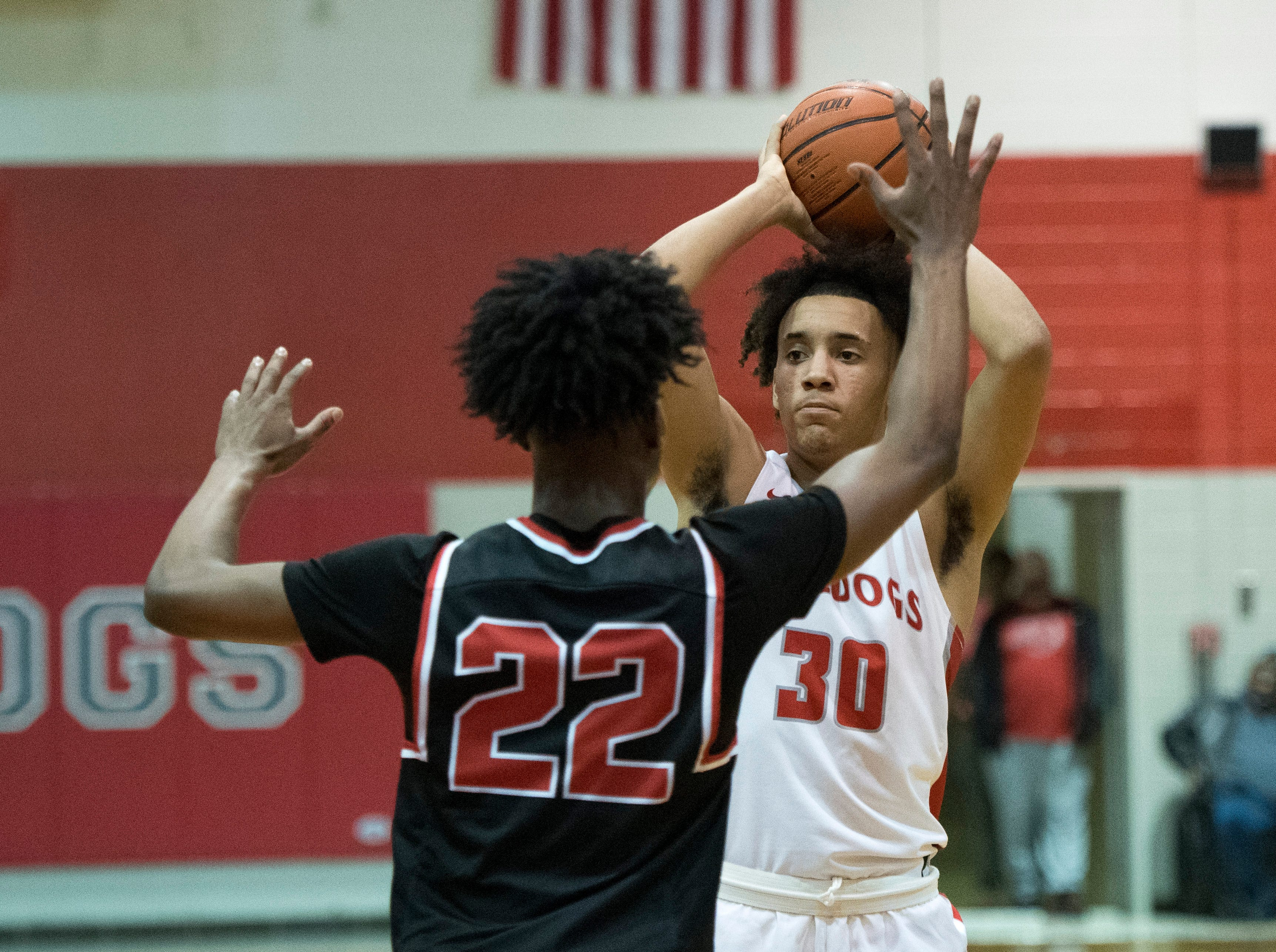 Bosse's Donovan Mcneal (30) passes the ball during the Harrison vs Bosse game at Bosse High School Tuesday, Feb. 12, 2019. The Bosse Bulldogs won 74-56.