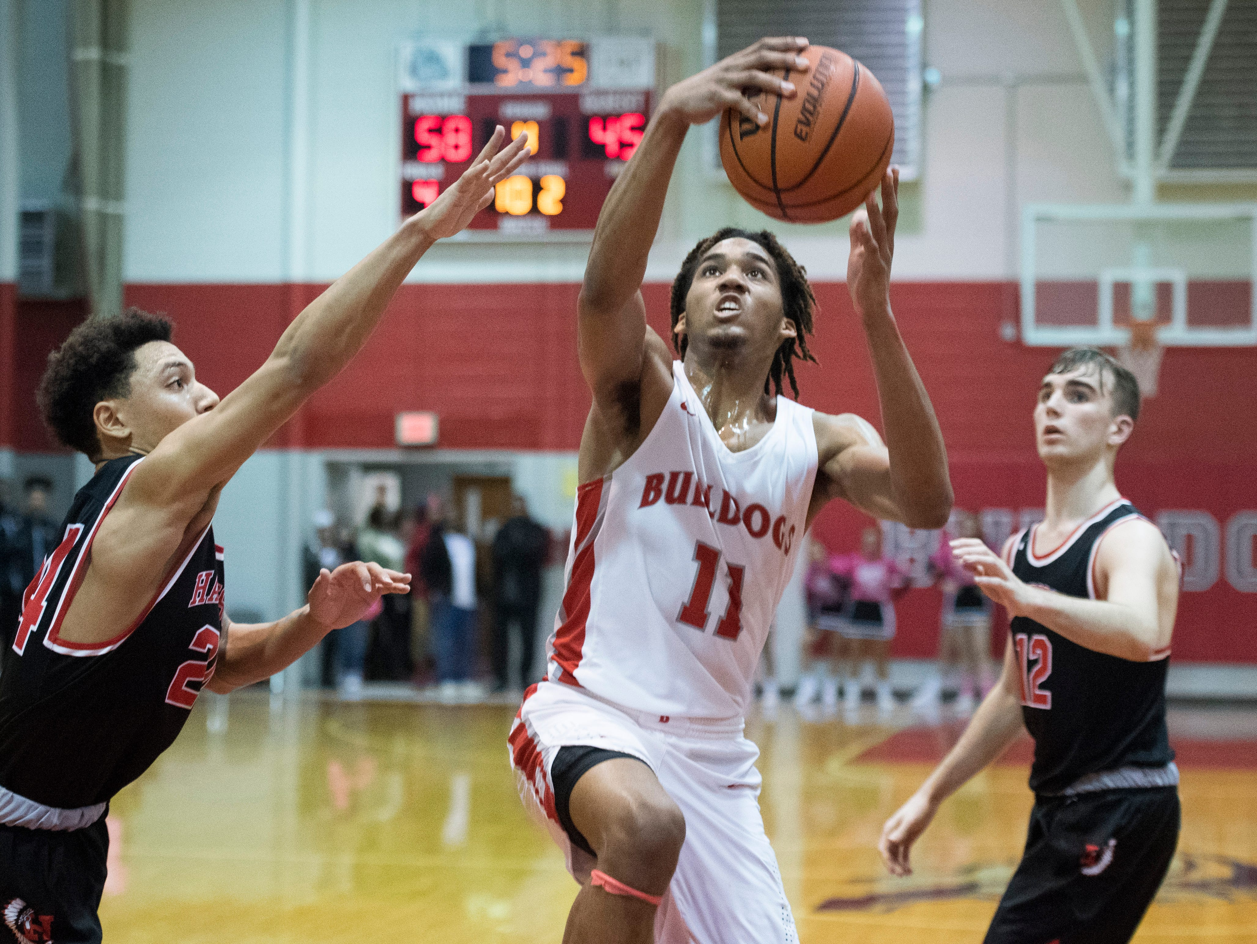 Bosse's George Madison (11) takes a shot during the Harrison vs Bosse game at Bosse High School Tuesday, Feb. 12, 2019. The Bosse Bulldogs won 74-56.